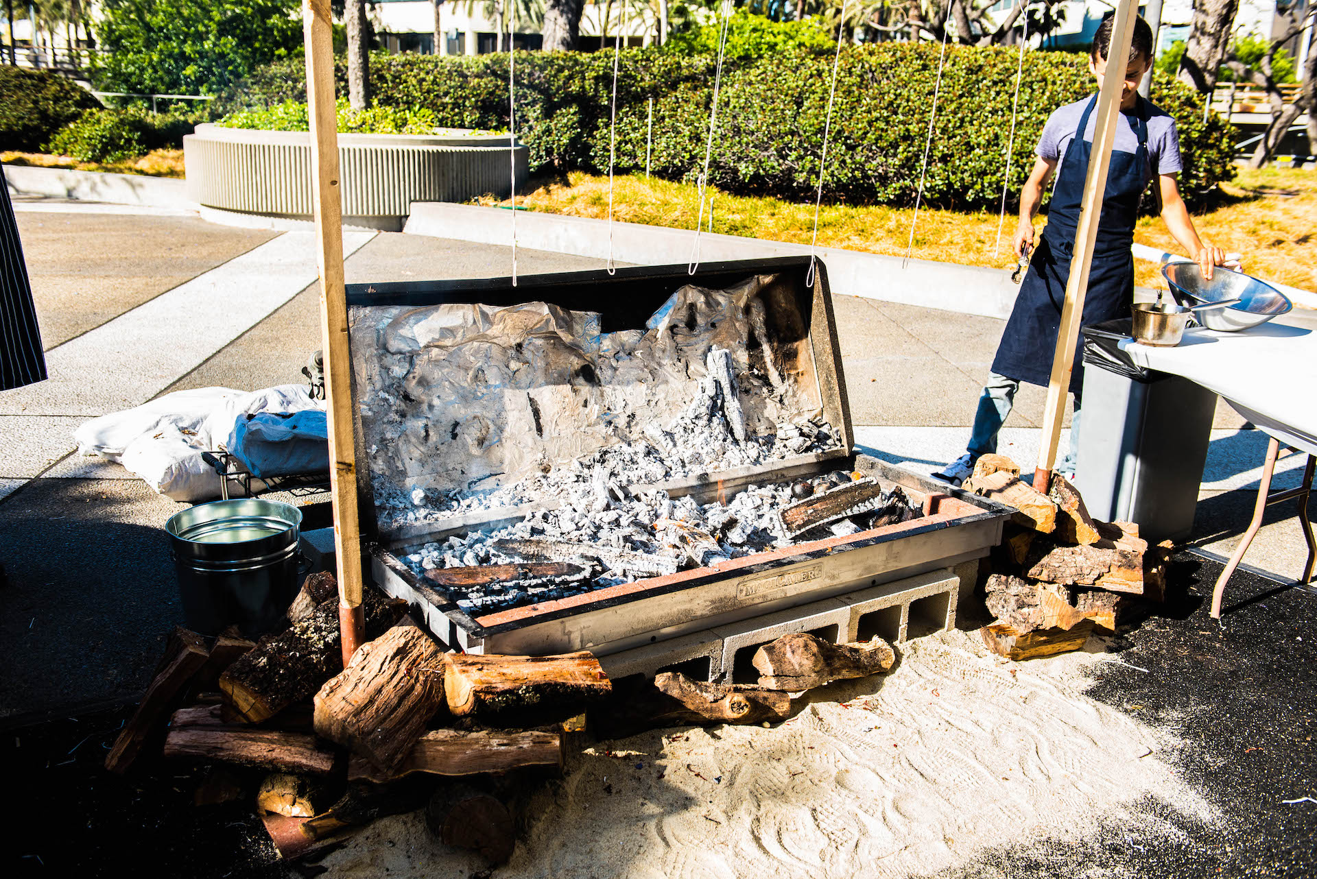 April's temporary barbecue pit is a serious affair.