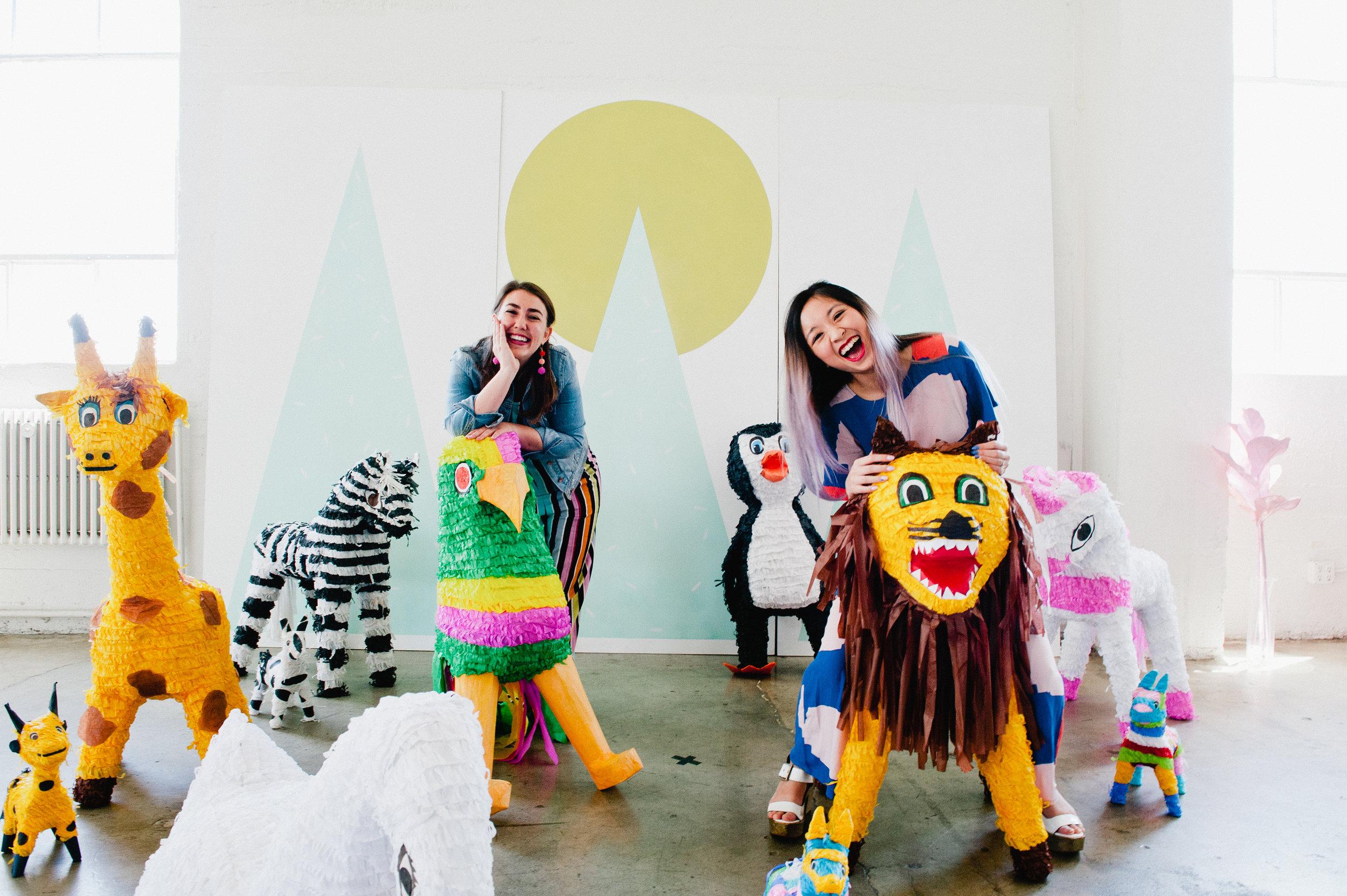 Miraya (left) and Liang (right) at the   piñata petting zoo.