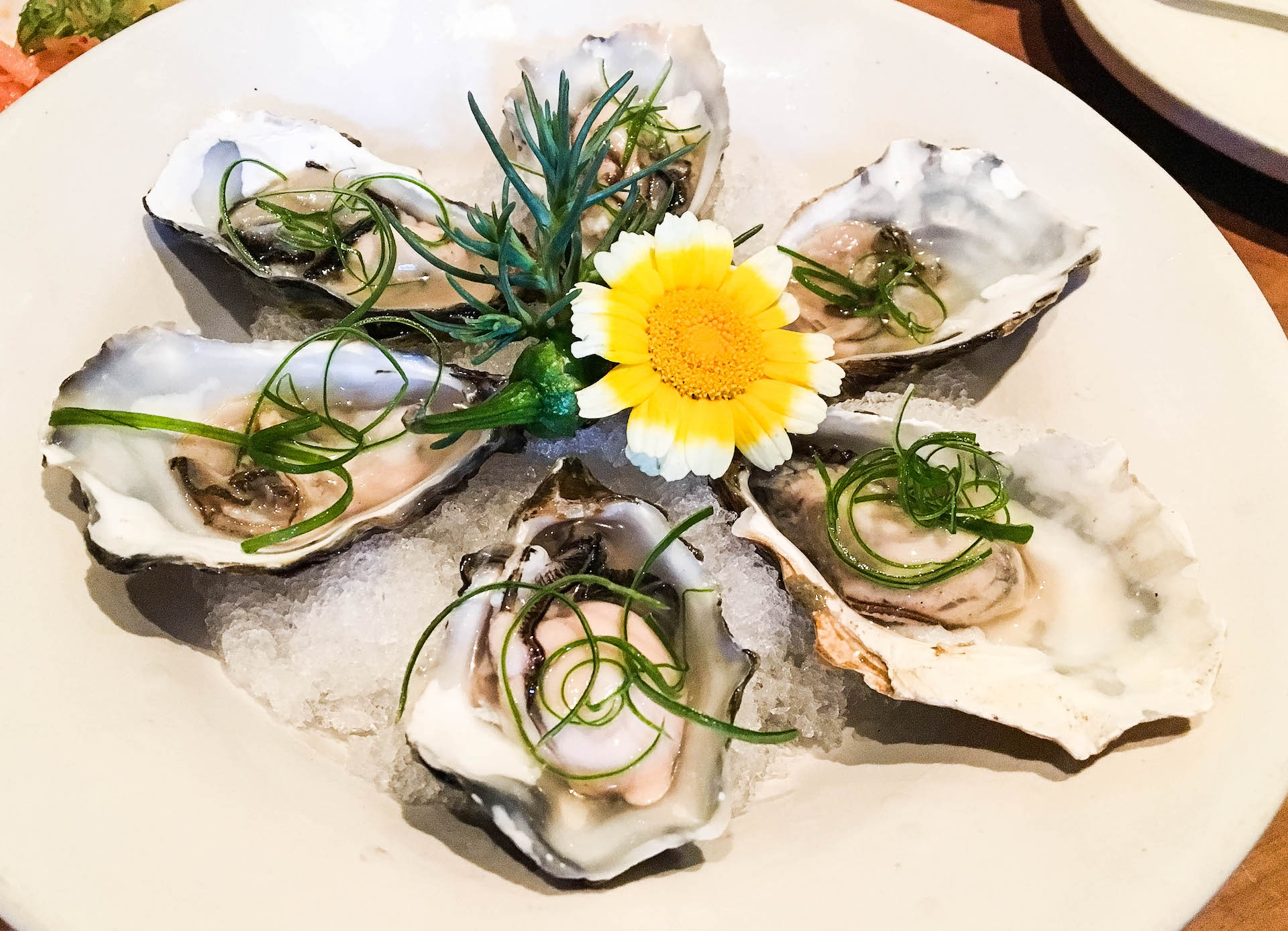 Oysters with dashi, scallions, and lime.