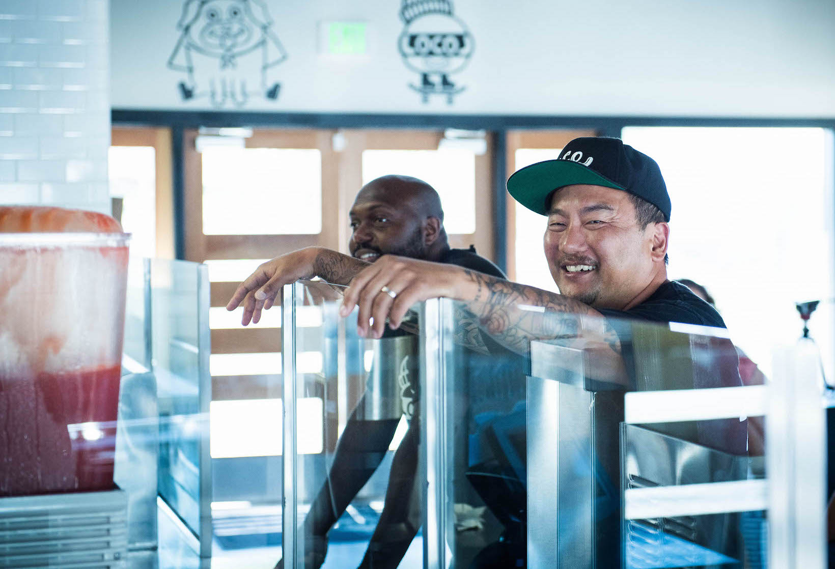 Roy Choi (right) in front of Locol in Watts with one of his managers, Terry (left).
