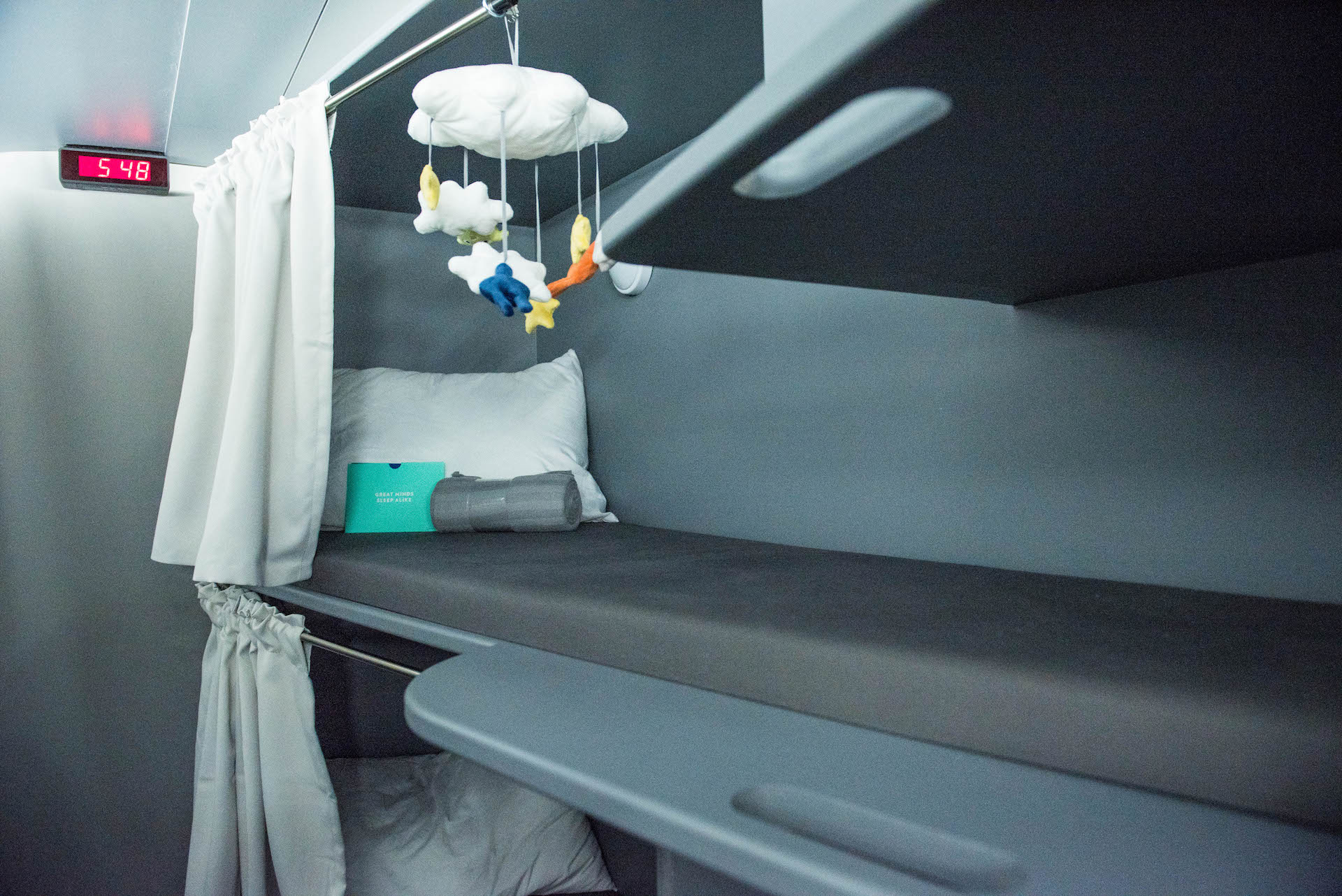 Tucked in the back of the plane there are bunk beds. Yup, you can finally sleep in a real bed during a long haul flight.