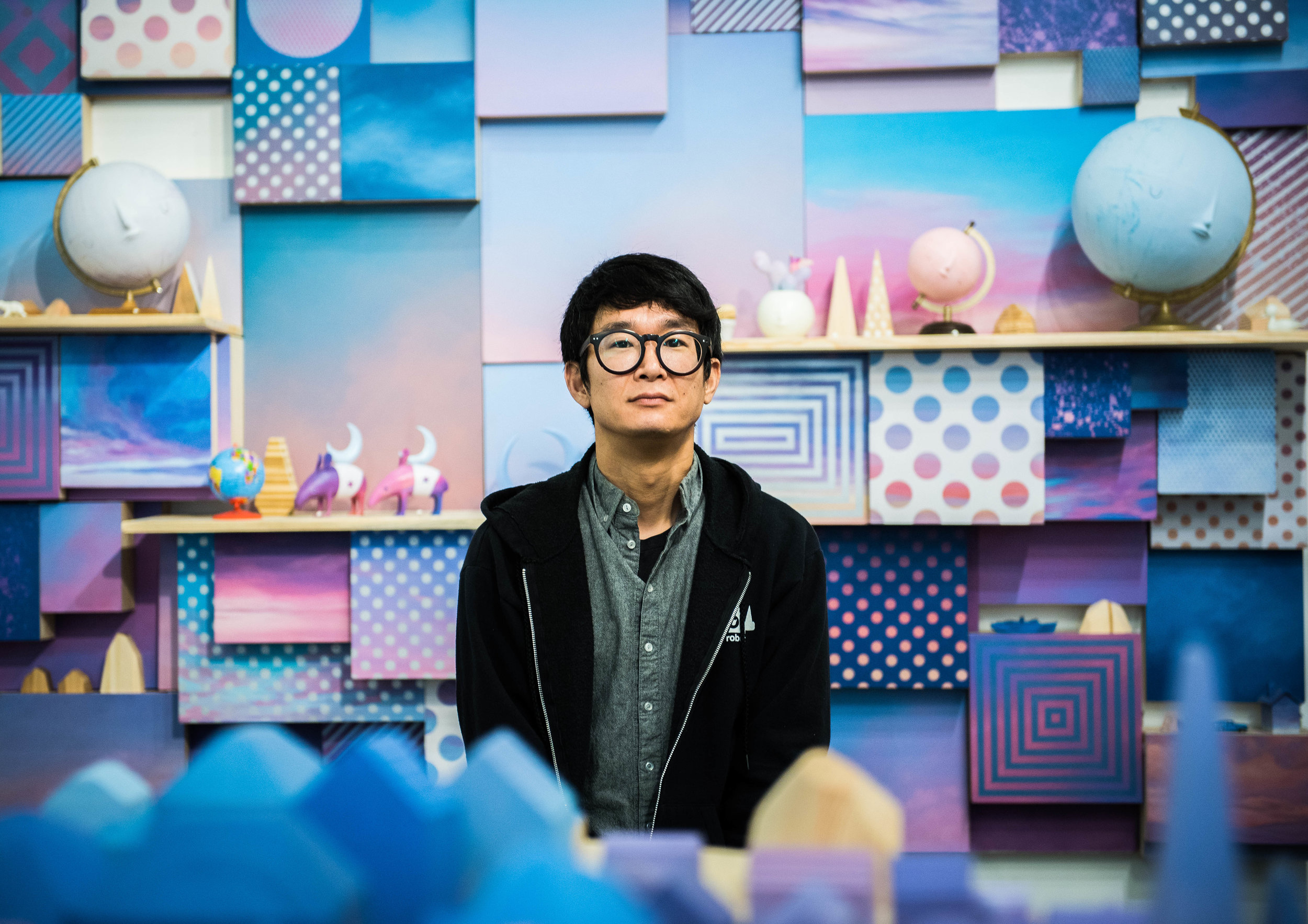 "Yoskay Yamamoto stands within his latest exhibit ""Homebound"" at the Giant Robot 2 Gallery. Photo taken by George Ko."