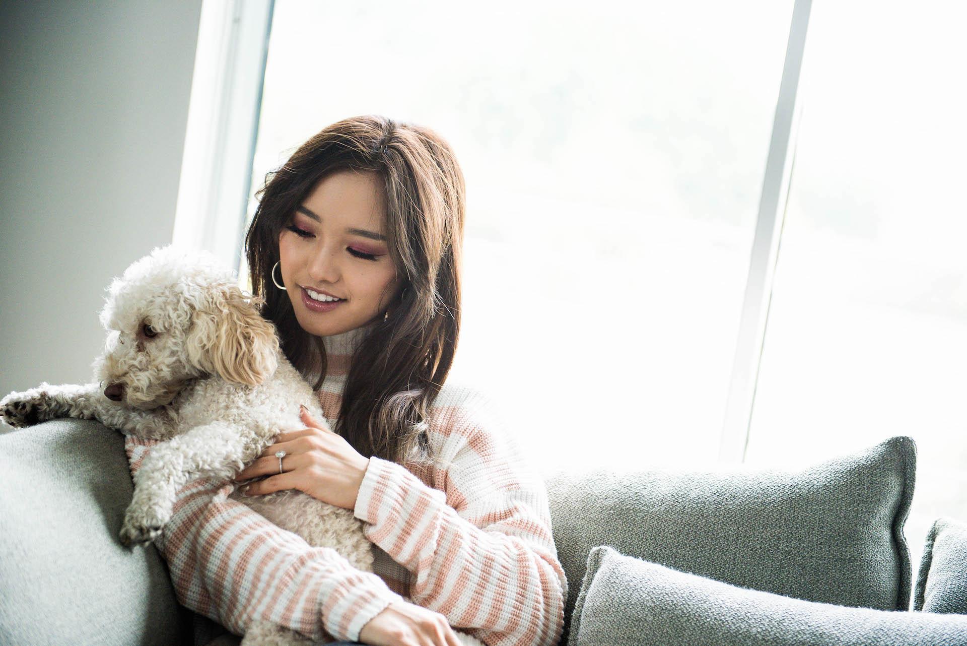 Jenn chilling with Cheeki wearing her  Salmon Stripe Sweater  from Eggie. Photo by George Ko