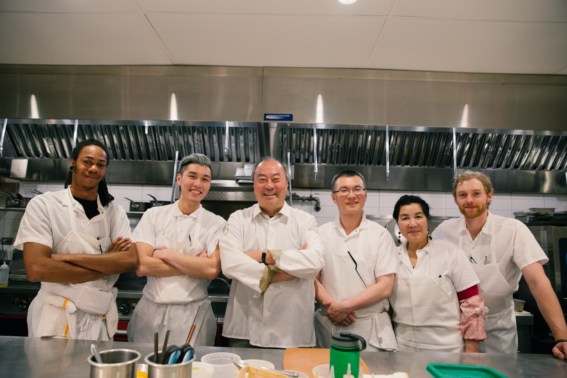 George Chen (center) and the Eight Tables team.