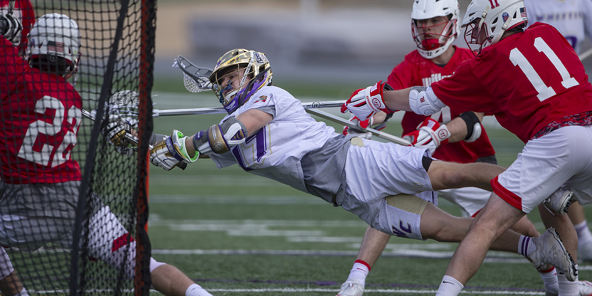 First-year Attacker Sergei Jacobs dives in an attempt to take a shot on goal.