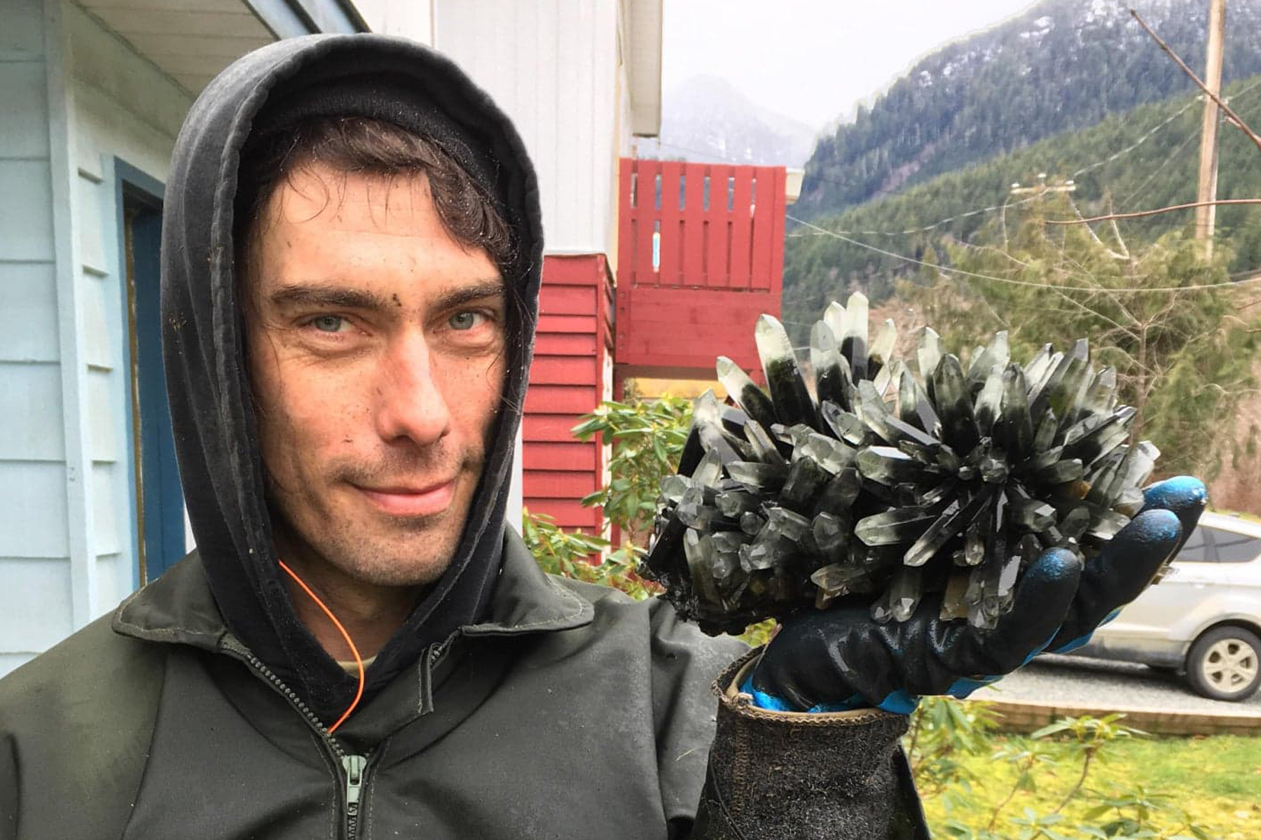 Forest Crystals partner and miner Chris Manahan shows off a phantom quartz cluster from his claim  photo submitted
