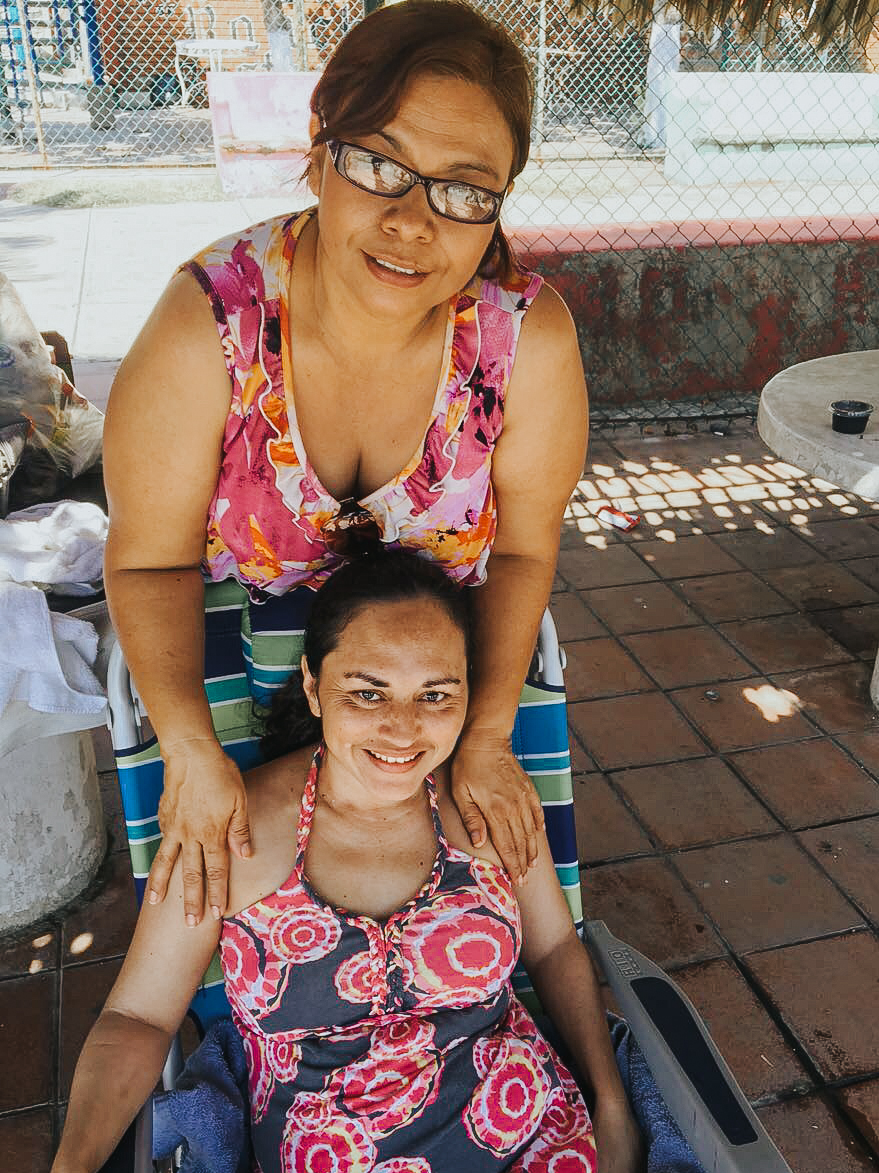 Evelyn, our Program Manager, with Jasmine on their recent beach day.