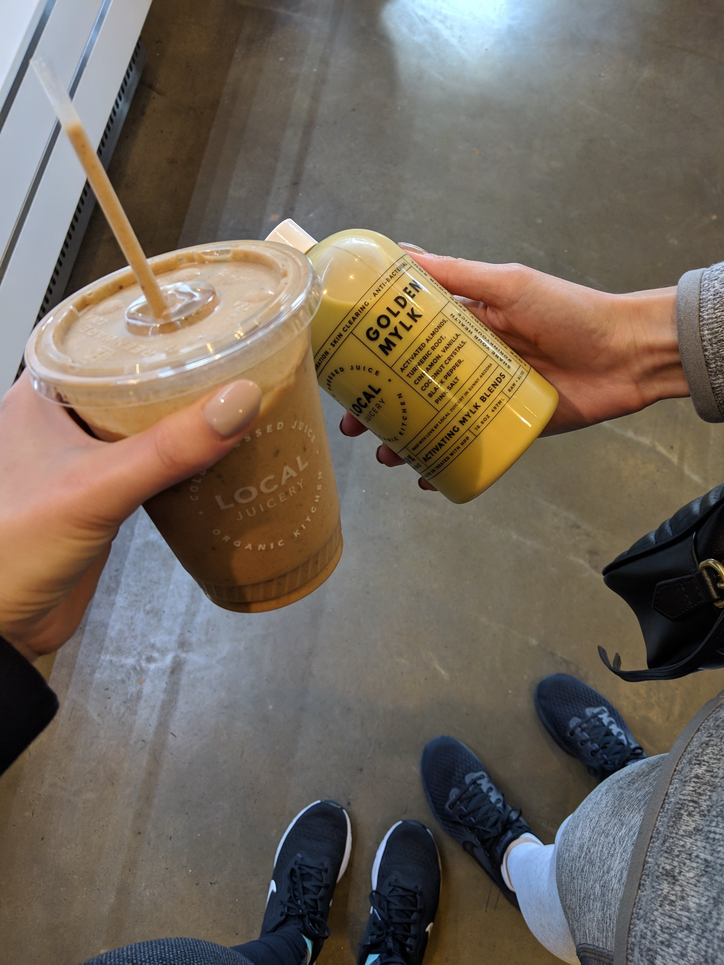 Having a smoothie and golden mylk at Local Juicery in Sedona, AZ | Watson & Walls
