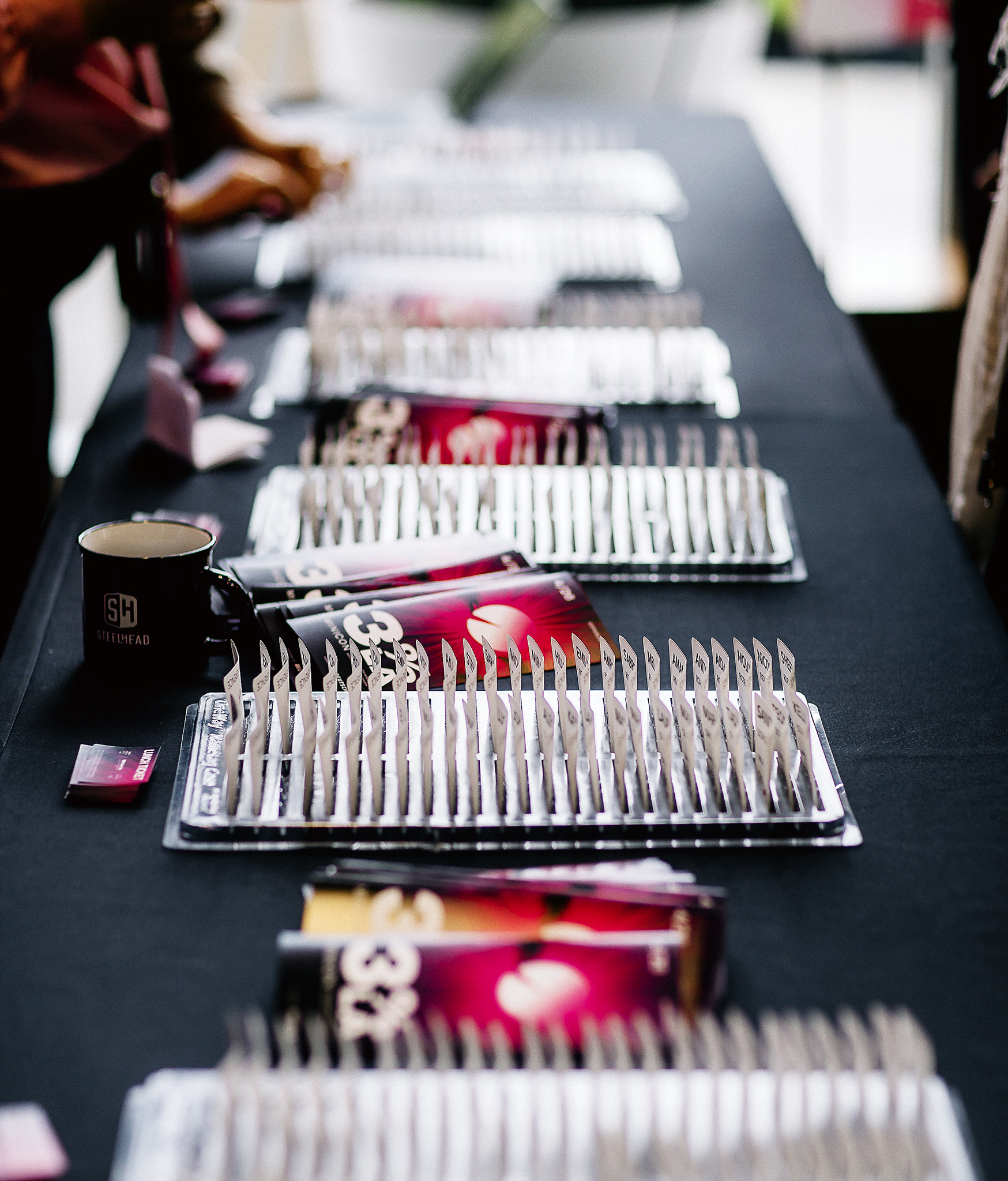 Name badges await the arrival of attendees at the 3% Mini-Conference at the Steelhead headquarters in Los Angeles on April 26th, 2018.