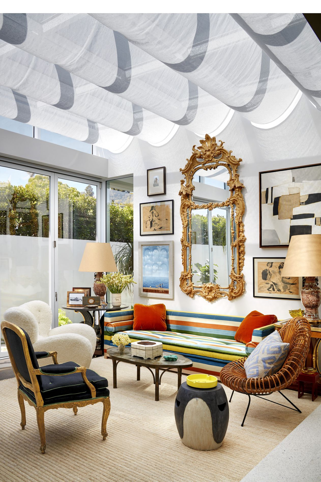 The sunroom's custom sofa is in an ikat stripe by Slightly East, the vintage Flemming Lassen armchair was purchased at Sotheby's, and the Louis XV chair is covered in an Old World Weavers silk-linen. The vintage cocktail table is by Philip and Kelvin LaVerne, and the ceiling is draped in a Rogers & Goffigon linen. The collage ( top right ) is by Edoardo Menini.   DESIGNER MILES REDD PHOTOGRAPH BY TREVOR TONDRO