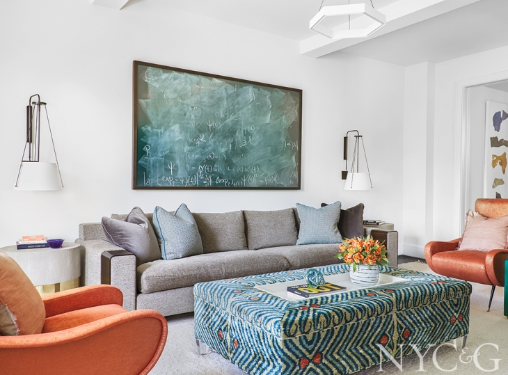 The library/family room features a  Holly Hunt  sofa and a custom ottoman upholstered in a silk velvet ikat from Slightly East.   PHOTOGRAPH BY EMILY GILBERT DESIGNER LILLY BUNN