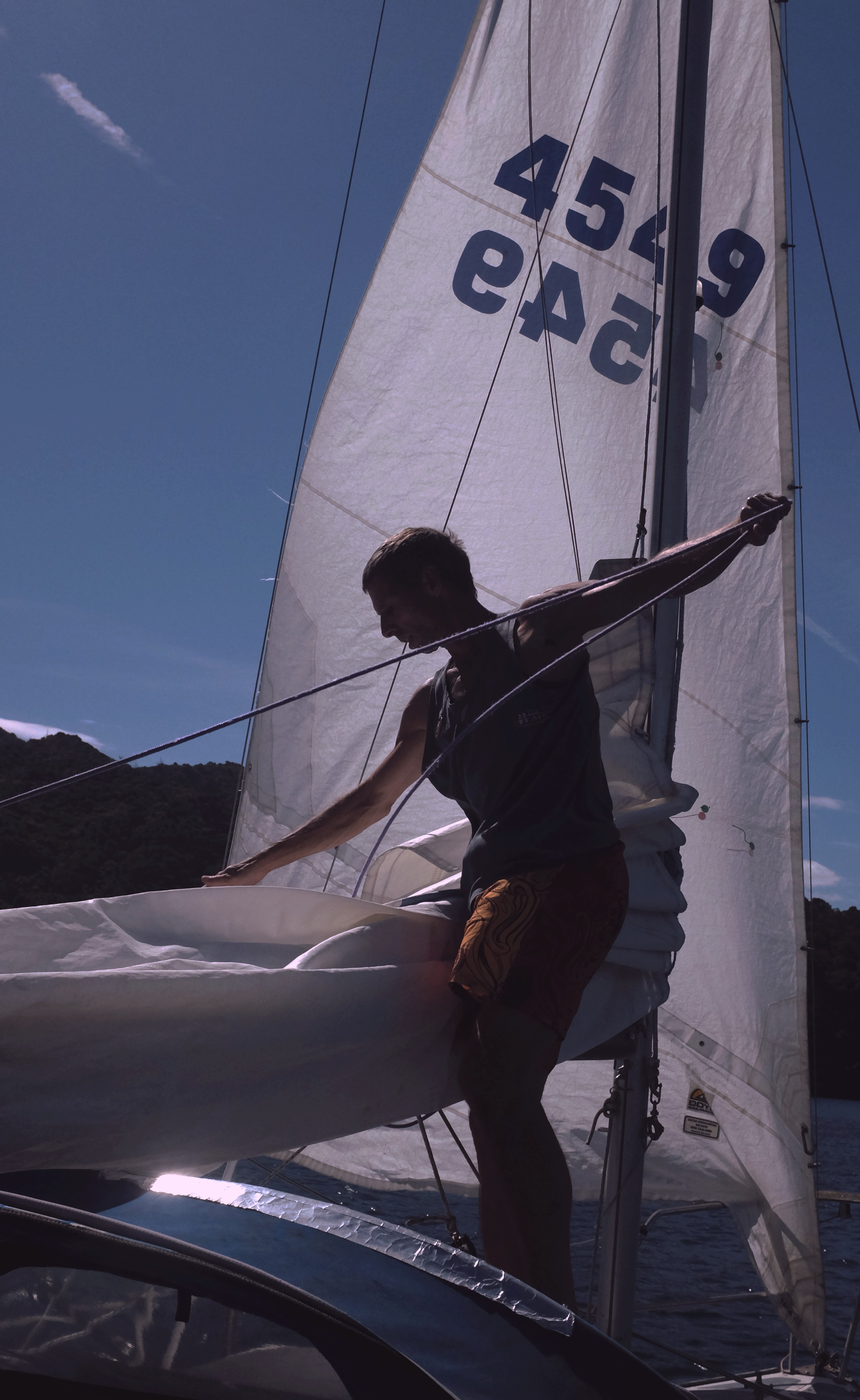 Taking down the sails.