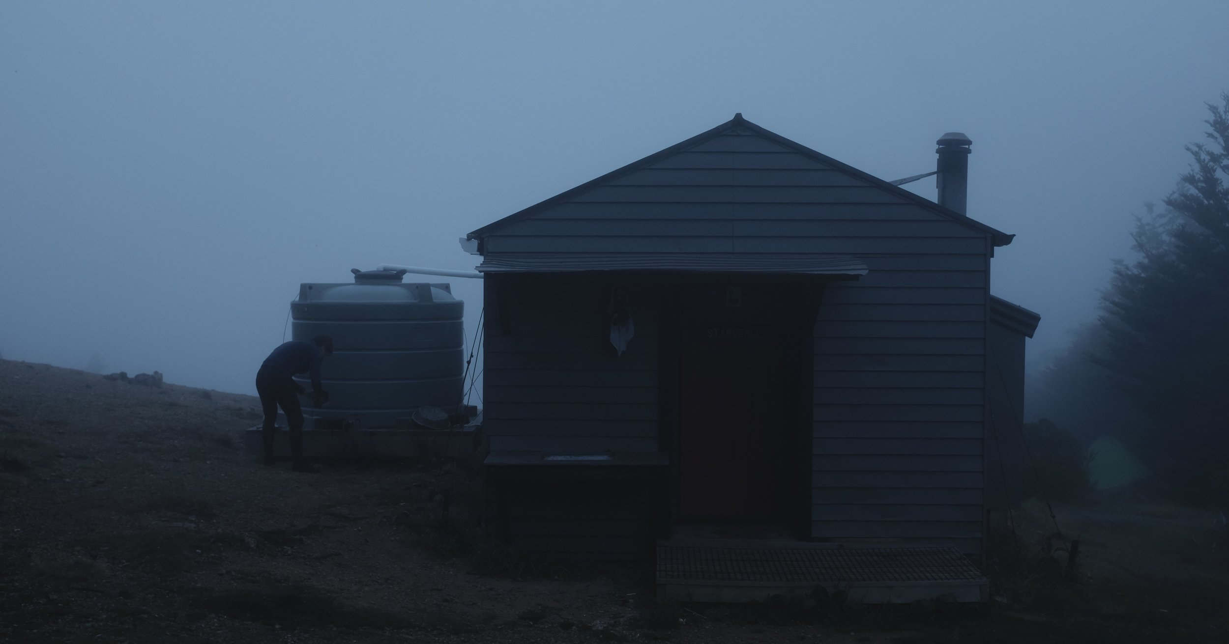 Reaching Starveall hut in the late evening mist.
