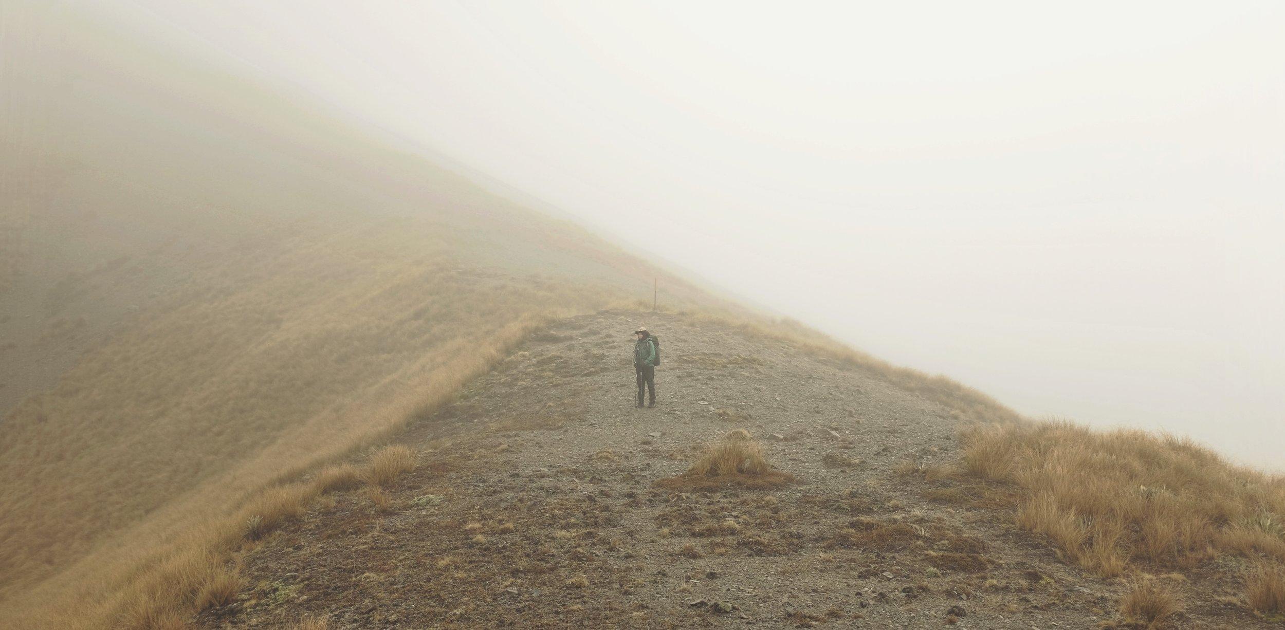 Misty rain hides the surrounding mountains.