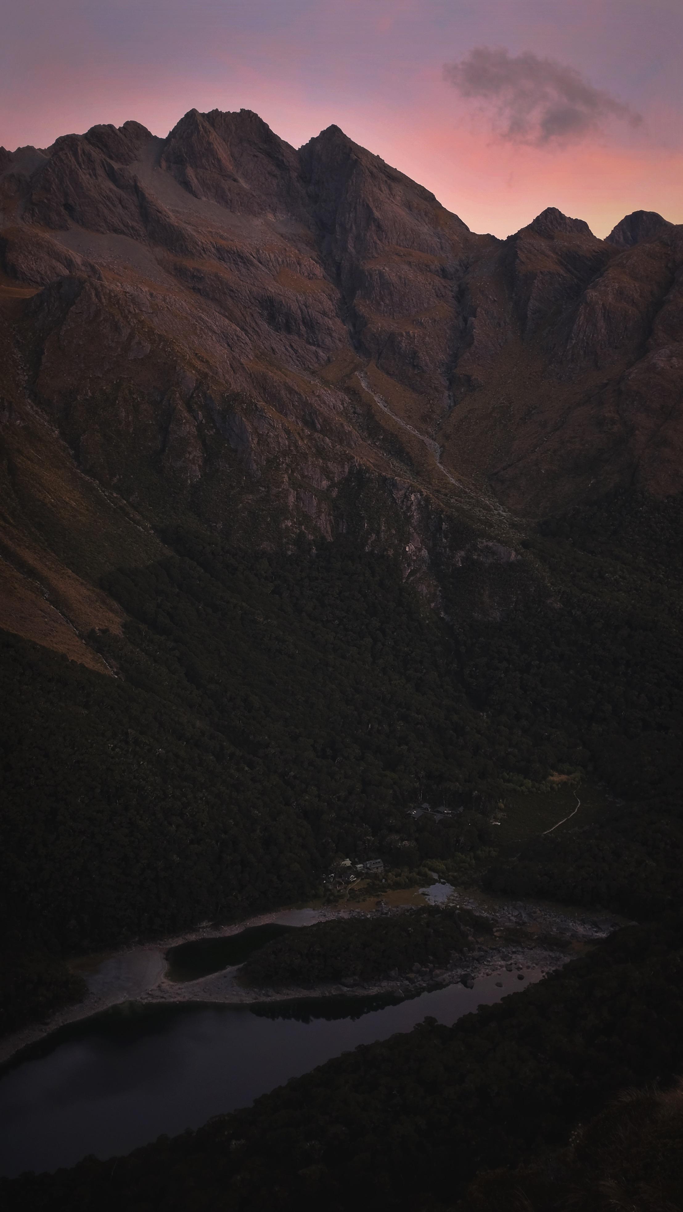 "Our campsite & ""hut"" far below as the sky darkens."