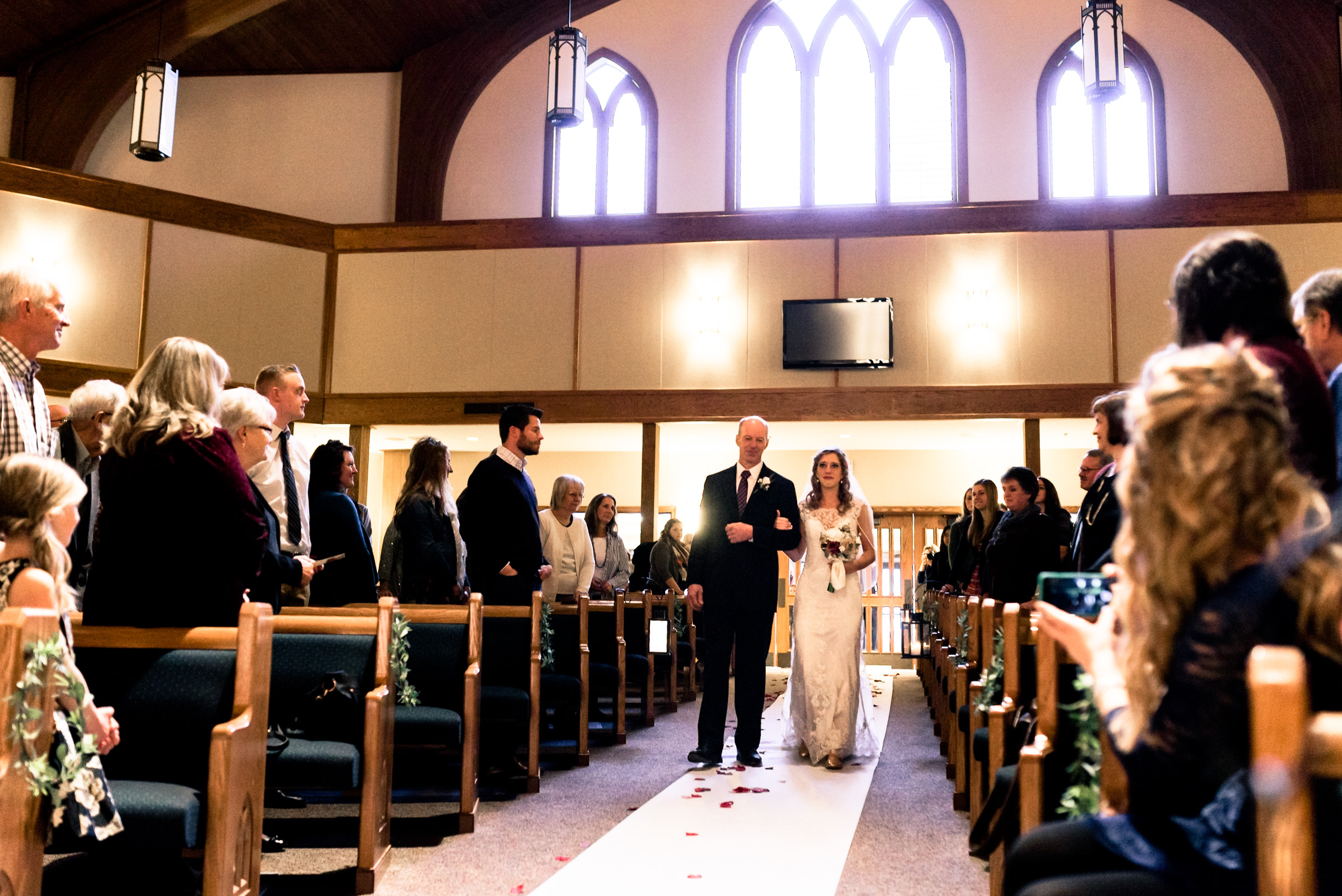 wedding, bride coming down aisle, bright church, ceremony, photography