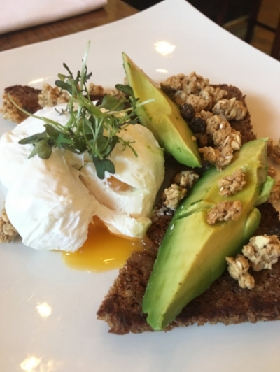Avocado on Toasted Rye Bread with Poached Egg and Granola