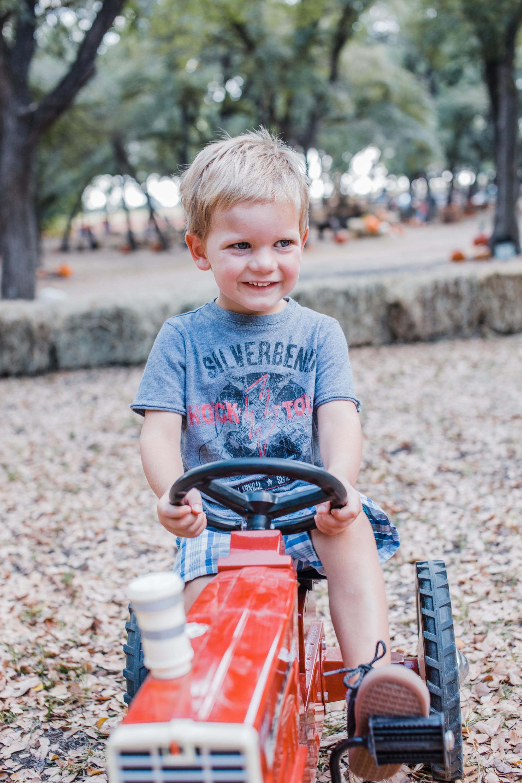 boy on tractor.JPG