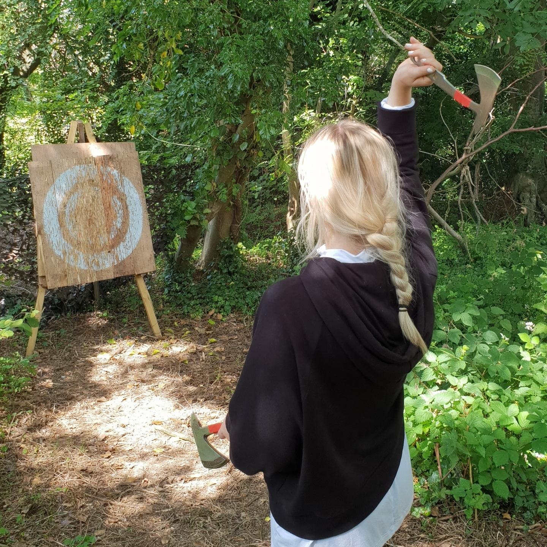 Molly in mid axe throw…