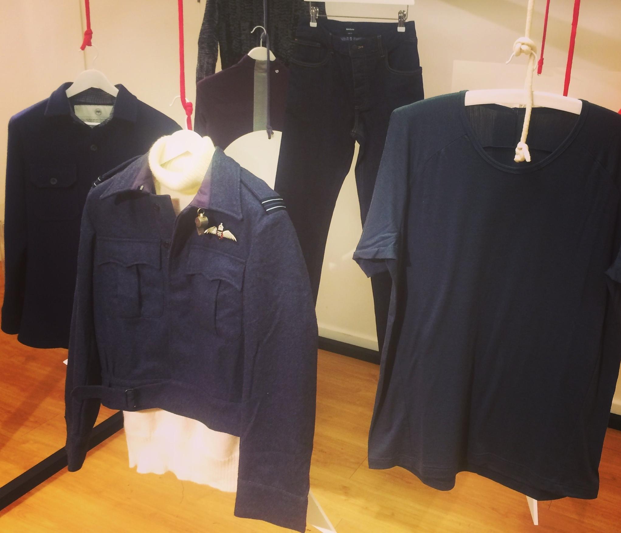 Vintage RAF pilot's wool battle-dress hanging amongst cutting edge modern wool garments