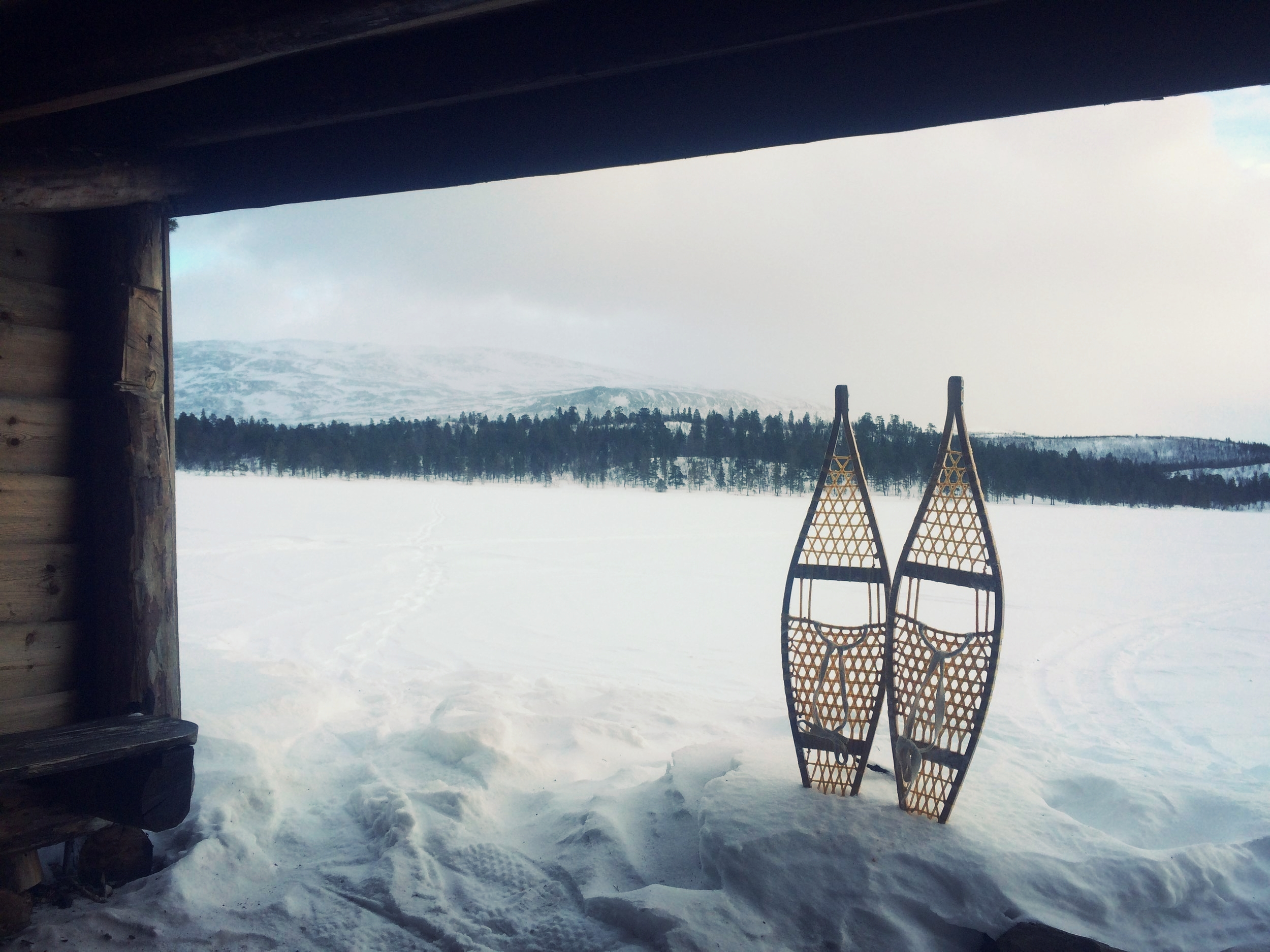 Snowshoeing across frozen lakes in Northern Norway