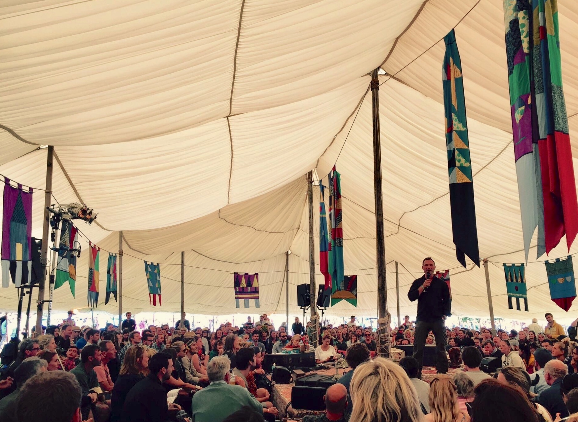 john hudson speaking at wilderness festival.png