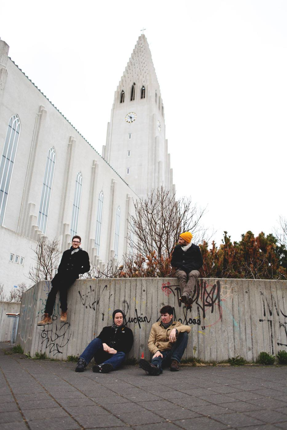Lounging outside of Hallgrímskirkja with some local graffiti.