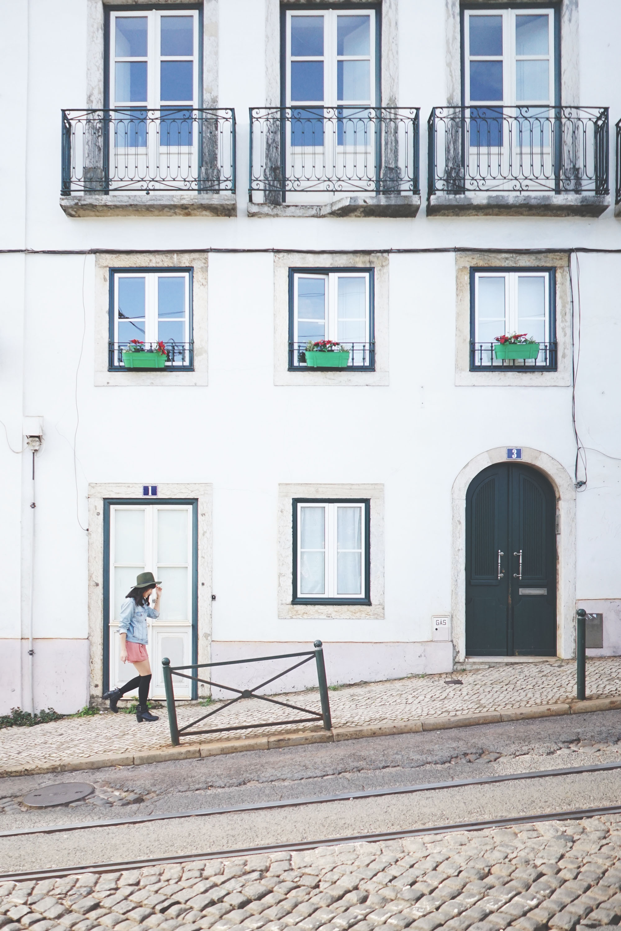 Casually strolling along one of the many uphill streets of Alfama and being nonchalant.