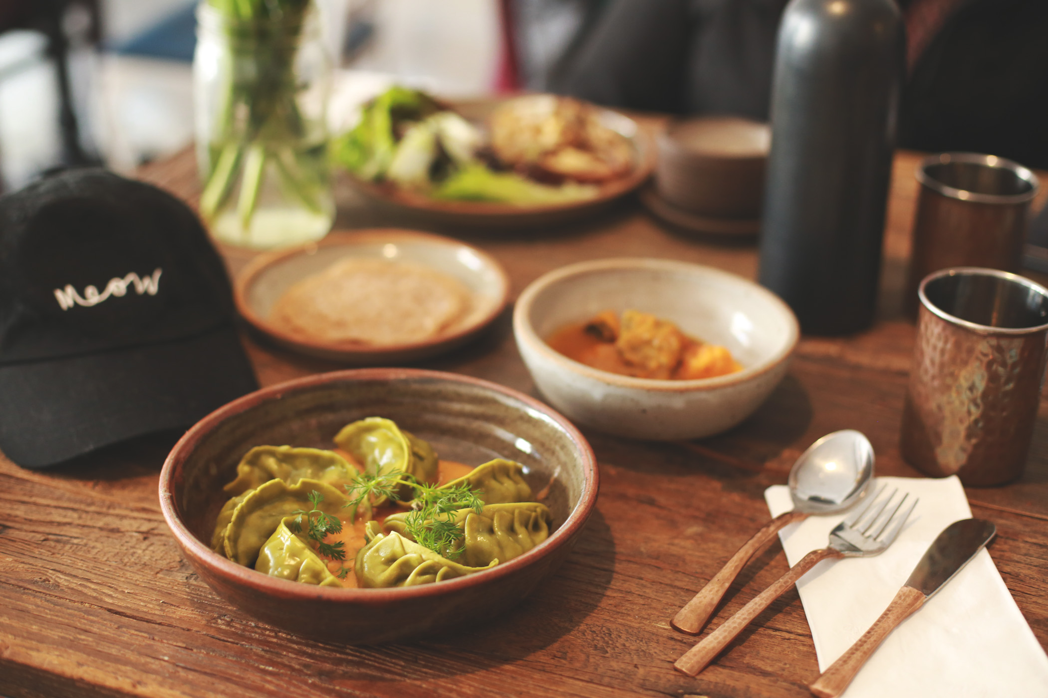 Behind the momos, you can spot the buttercup squash soup, served with toasted wild chives and buckwheat crepes.