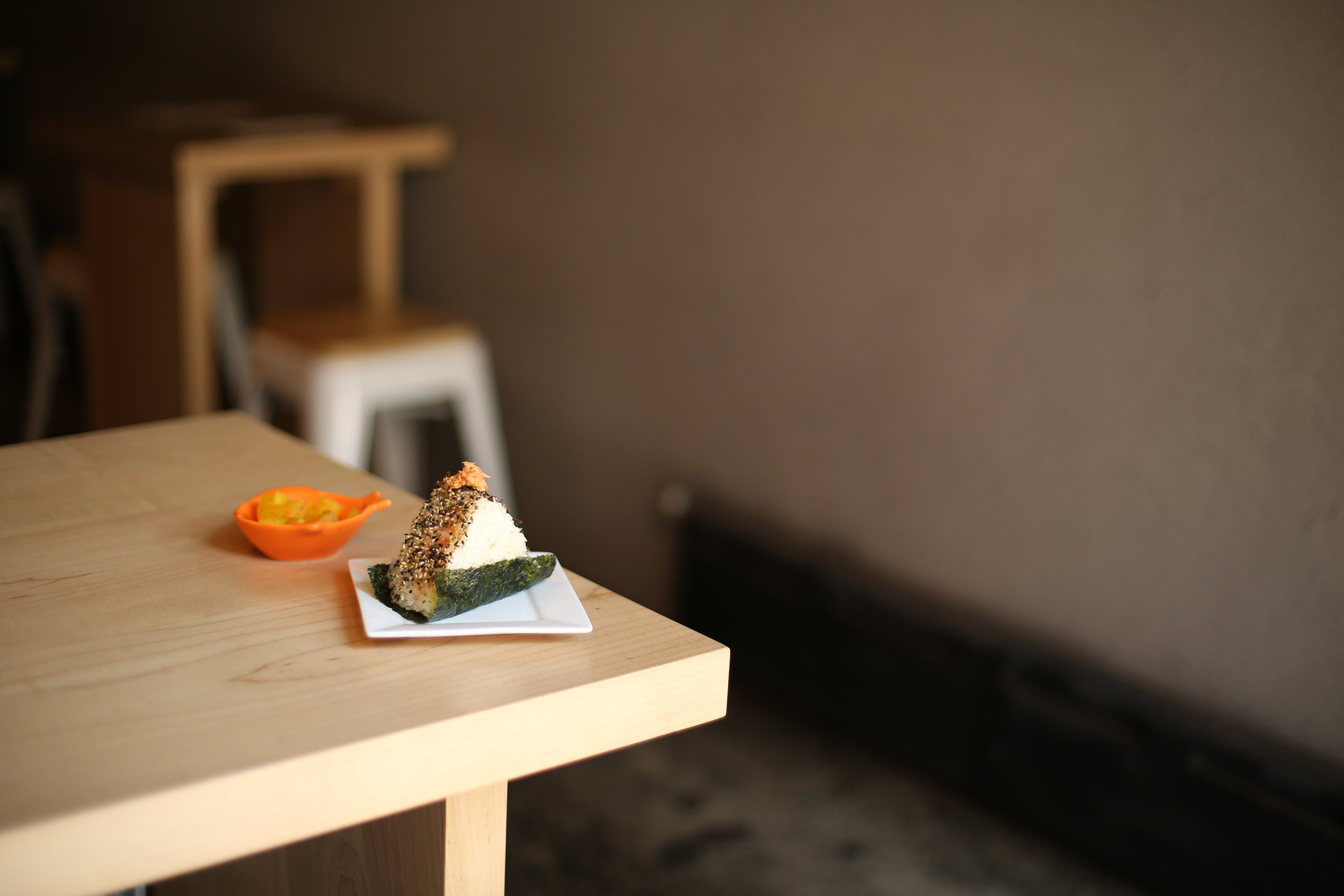 Spicy tuna onigiri, a sweet and sour rice ball appetizer.