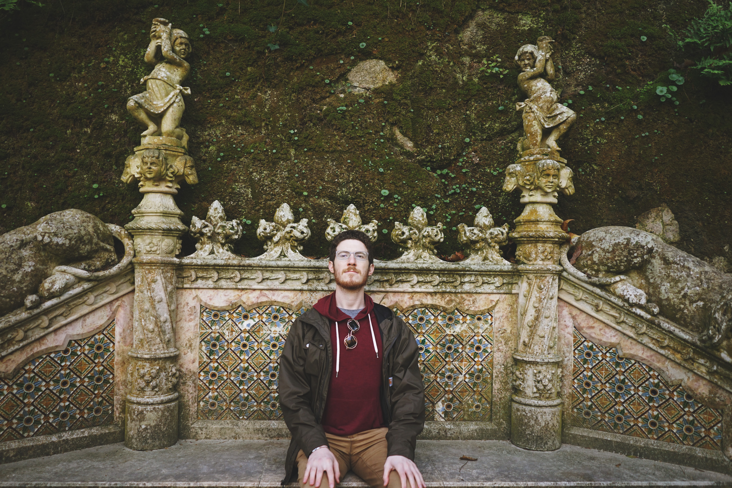 Jeremy rests on a Gothic bench decked out with dog heads, cherubs, and lions (located between the lake and the Loggia).