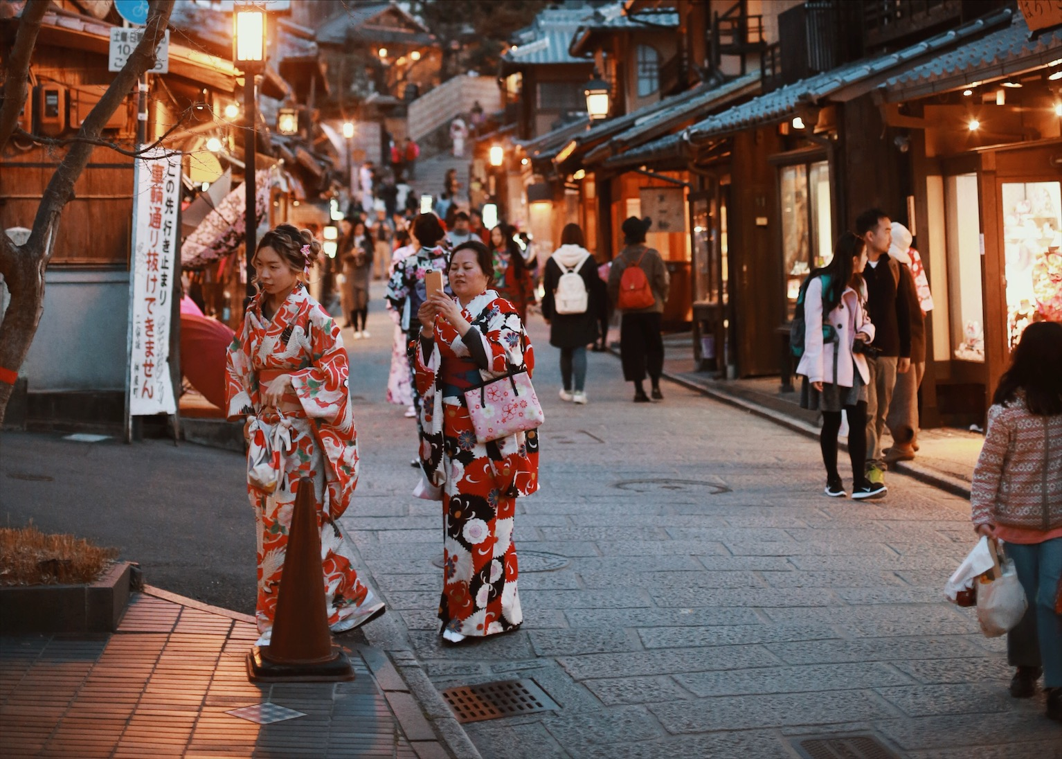 Tourists pose in rental kimonos. While we didn't have time to try on the kimonos, we wish we had. Locals in Kyoto allegedly love tourists taking the time to wear the traditional clothing. As most Japanese no longer wear such clothing except for very special occasions, the fact that tourists want to wear such clothing is seen as a reaffirmation of Kyoto's cultural legacy.