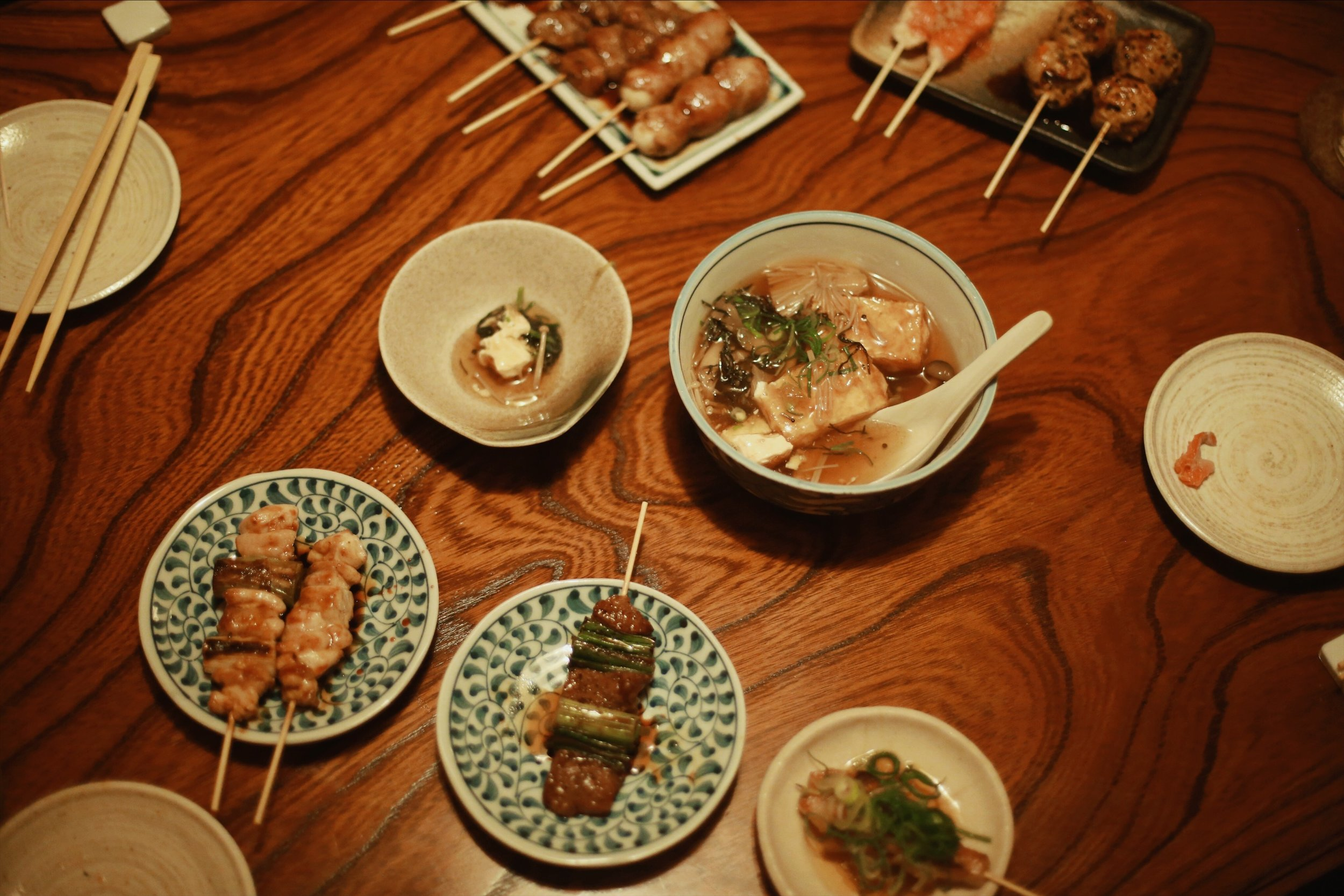 A selection of delicacies, including fatty pork, organ meat, and soft silken tofu.