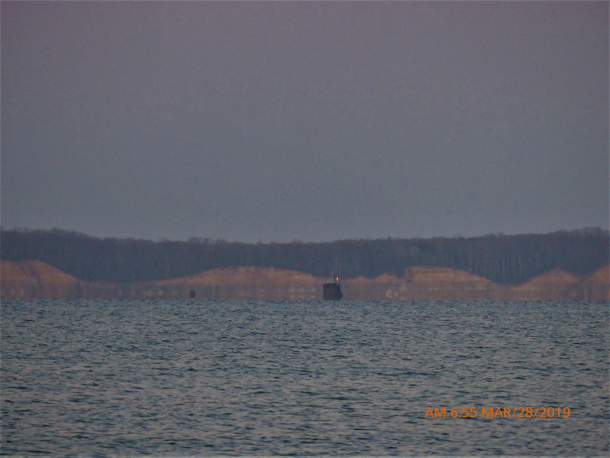 USS  North Dakota  is visible passing Calvert Cliffs at dawn Thursday. Photo: Taylors Island Maryland/ Facebook