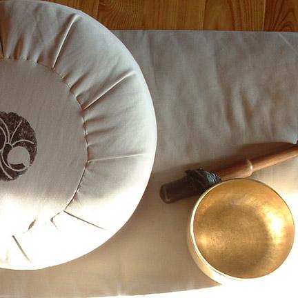 Smilingyogi meditation cushion, singing bowl.