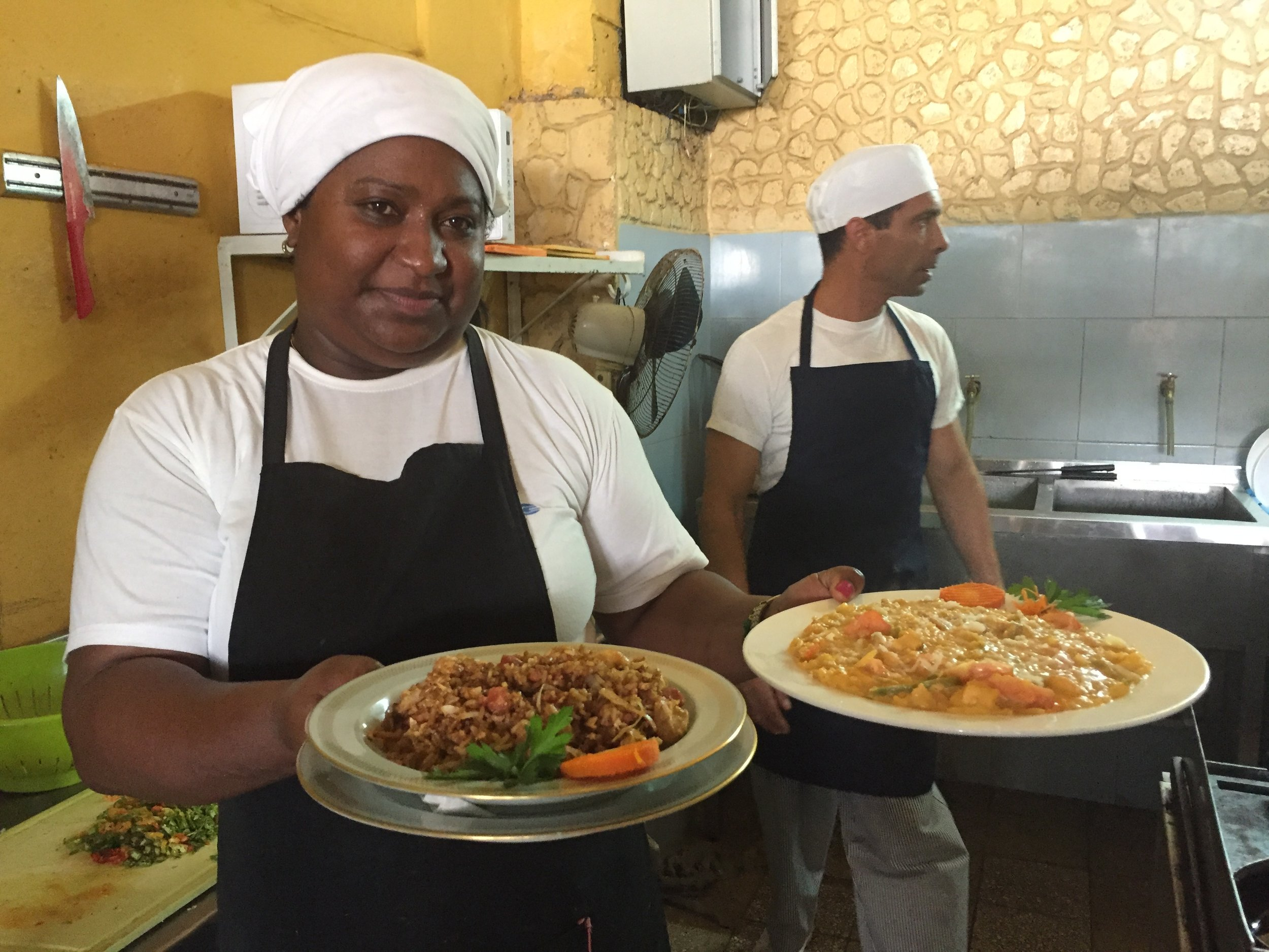 Dunia & Fernando in the kitchen at El Cimarron, serving up fried rice and seafood risotto cuban style.