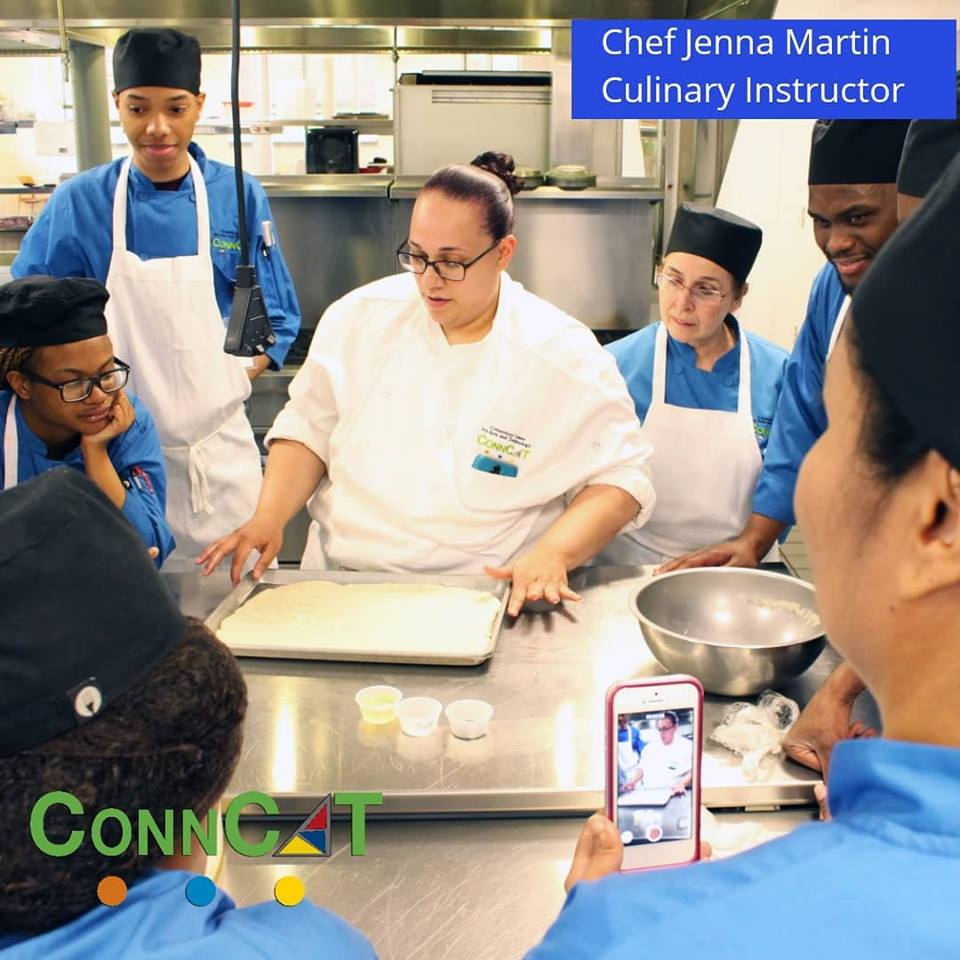 """Photo credit: ConnCAT via FaceBook: """"Chef Jenna with our culinary students giving a demonstration before they're sent to their stations to do it themselves."""""""