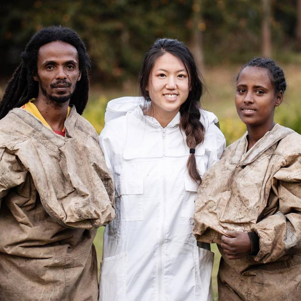 Beekeepers Sissay and Jeru stand with Maryiza Honey founder Ariana during a 2019 training in the Gera Forest in Ethiopia.