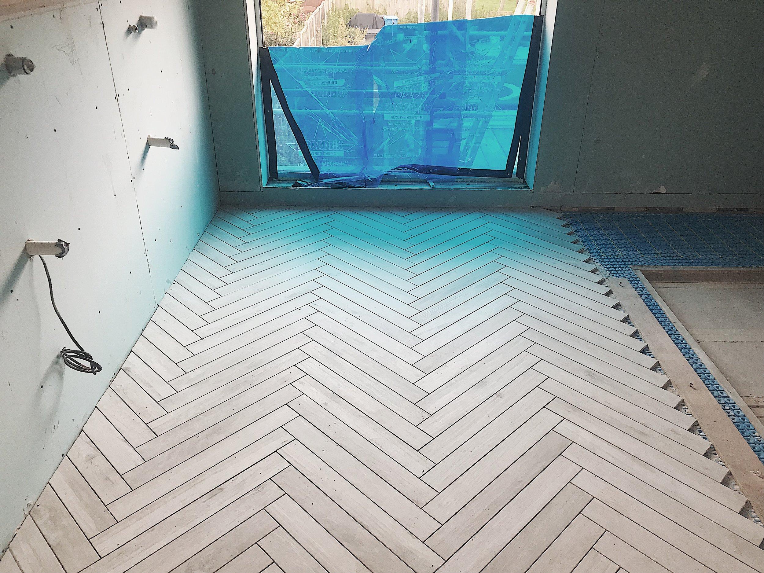 Tiles featured: Wood of Cerim waterjet to create herringbone