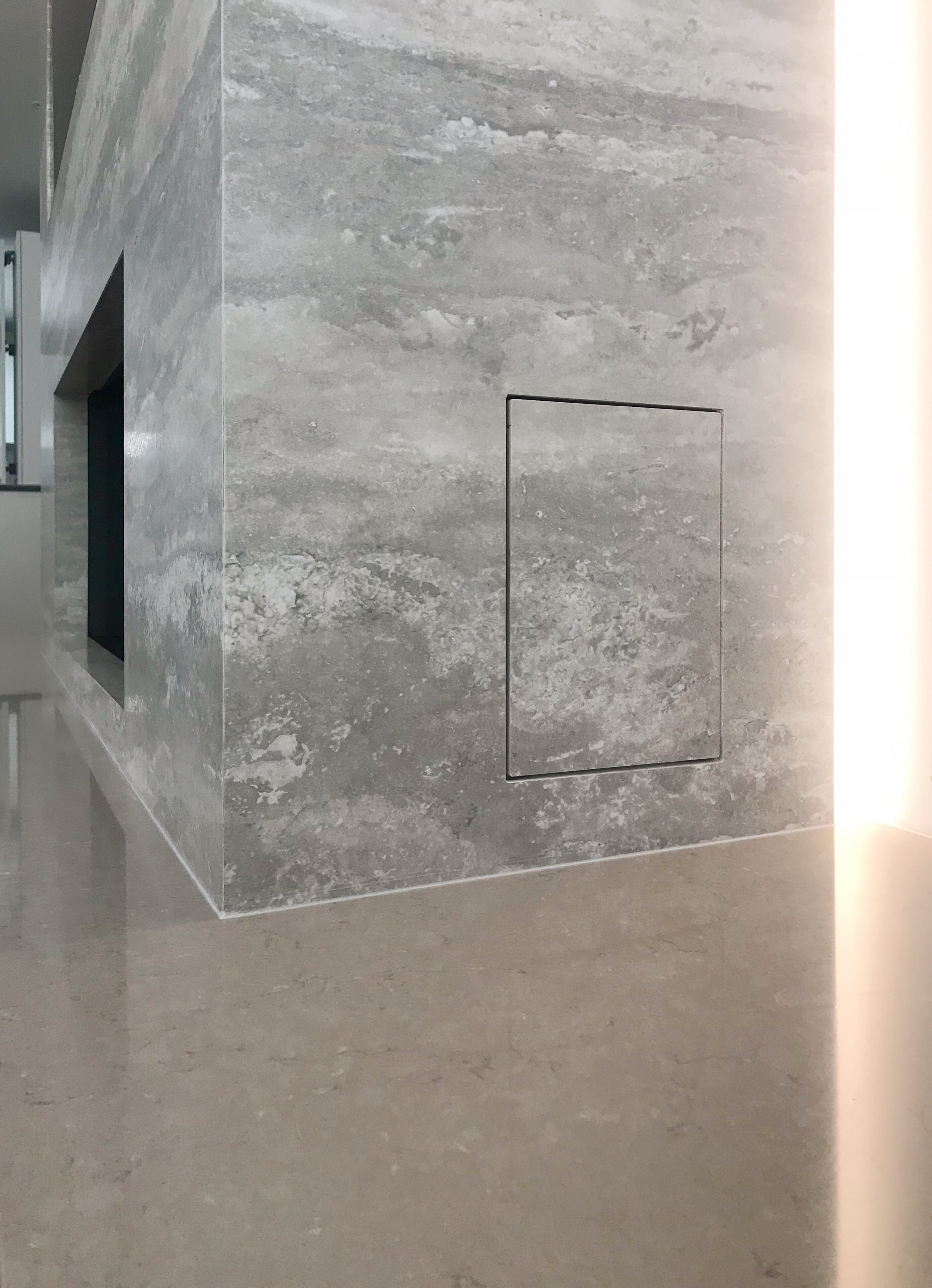 The access panel was waterjet cut and secured by magnets, however notice the material veining runs through to make it as seamless as possible