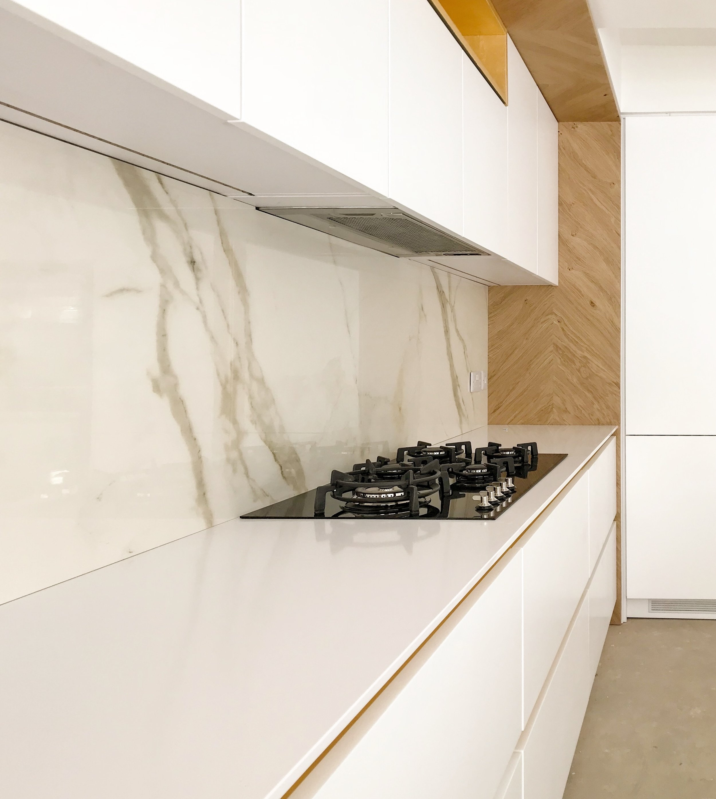 PietraCasa supplied and installed this kitchen splashback. Two pieces of Laminam 6mm templated and cut on site