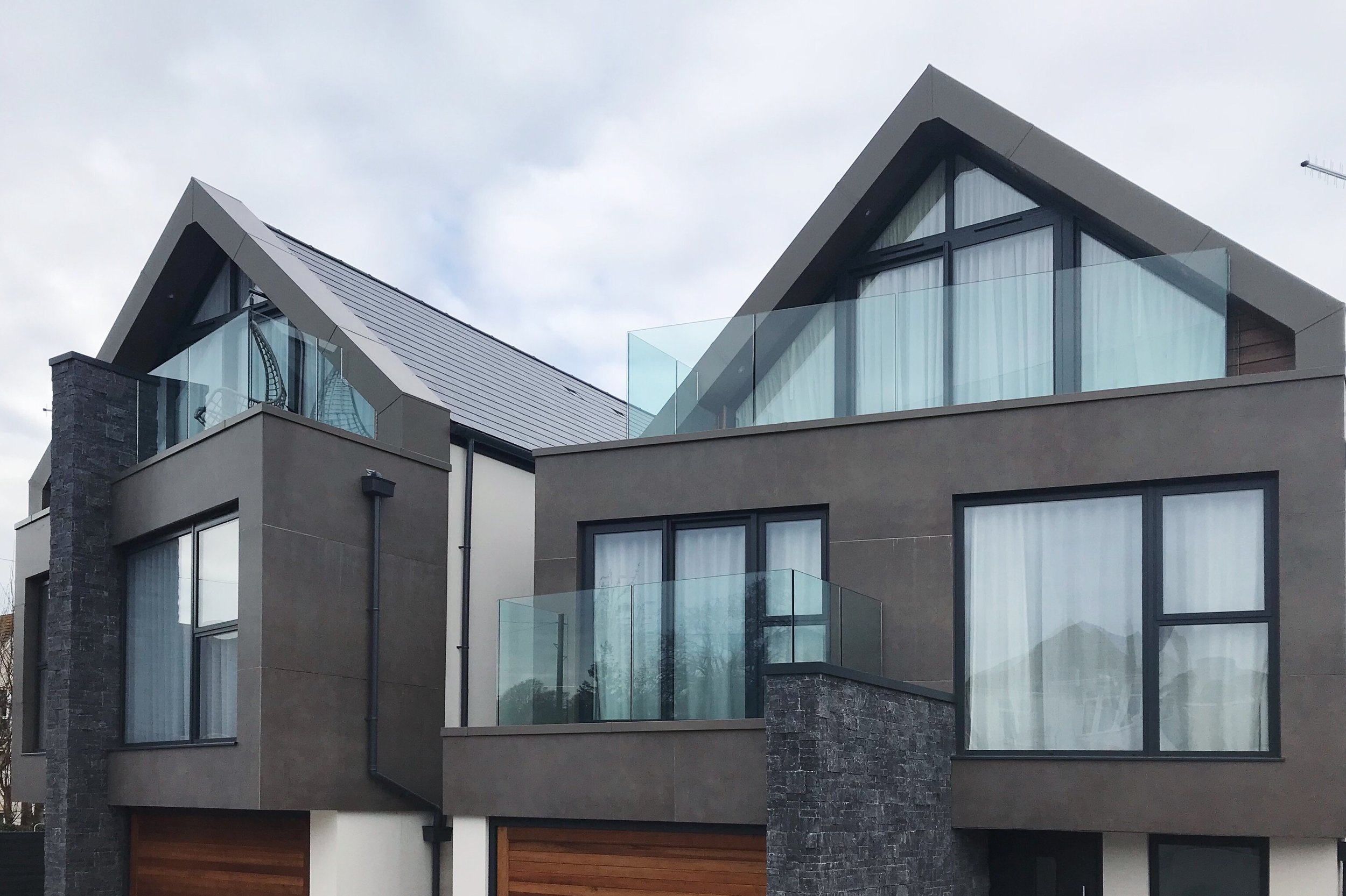 ARCHITECTURAL CLADDING - Being so close to the sea, rendered buildings look great for a limited time. Porcelain does not discolour, is non porous and has excellent thermal properties. This image is taken 12 months after the Floor Gres Industrial large format has been installed on the front and rear elevations of these two properties. It is possible to have metal, concrete, stone and marble effect porcelain that will look beautiful throughout time.Tile featured: Floor Gres Industrial Moka