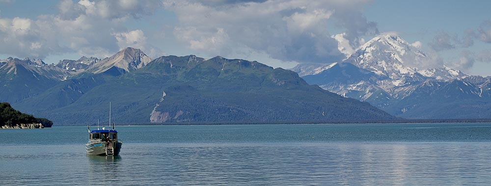 The  Stormy Skye  anchored off Duck Island. Mt Redoubt, an active volcano, to the far right.