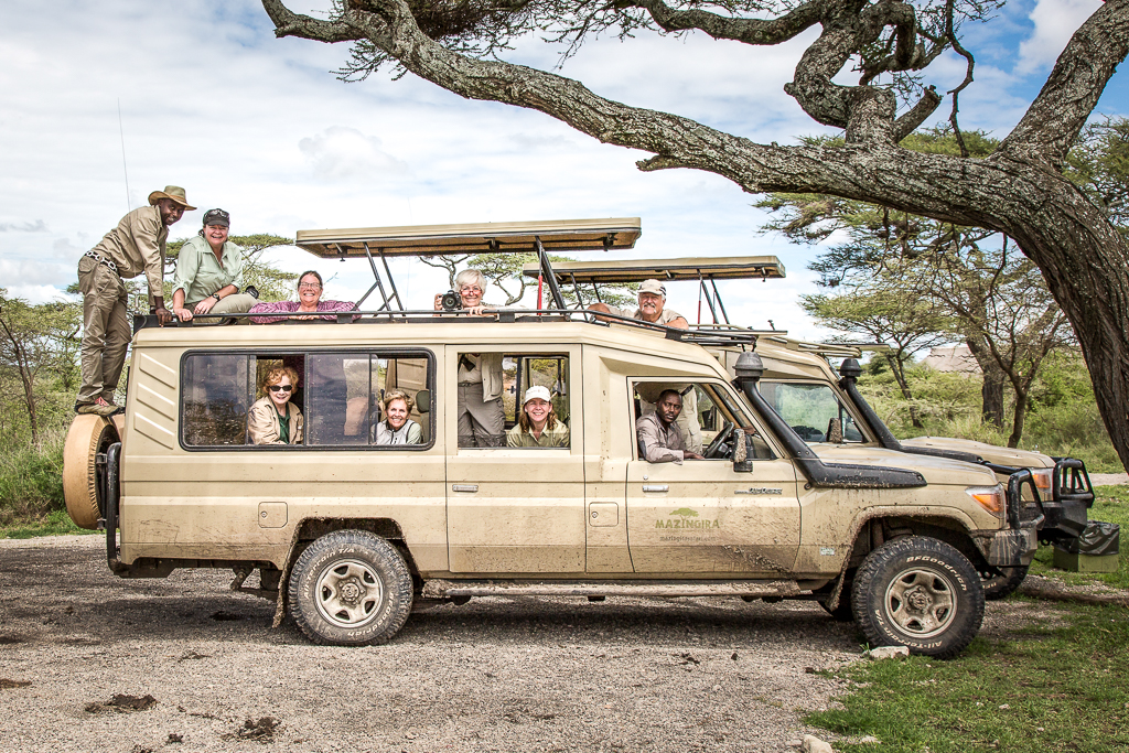 Maximum Comfort and Mobility - Whether on the ground or in the air, our safaris are equipped to quickly and skillfully position photographers in the best vantage points to capture their dream shots both creatively and safely.Our group of 10 photographers and two photo guides travel in the comfort of four custom-designed 7-seater Landcruisers, three photographers to a vehicle. Each photographer has a row of well-padded seats for themselves and their camera gear, with extra large windows either side and a pop-top roof above.Each safari vehicle has an expert local guide/naturalist with the photographer/trainers alternating between vehicles. All vehicles have a refrigerator stocked with an unlimited supply of bottled water, soft drinks and snacks.Once again we're offering the option of a hot air balloon safari over the Serengeti with a bird's-eye-view of the Great Migration from a unique perspective.
