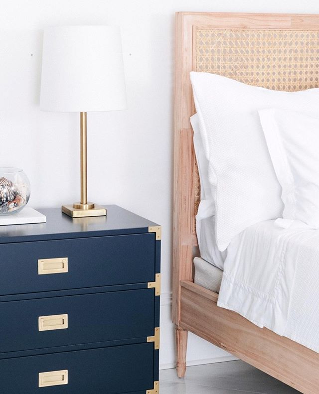 The Louie Bed from our newly launched bedroom collection. Inspired by our best-selling Louie Dresser, the Louie Bed features neoclassical elements, such as hand carvings and a caned panels. Leave the bed Raw for a natural look, or apply a custom finish to make this piece uniquely yours. Pictured here with our Carlyle Campaign Dresser in Navy. Tap to shop!