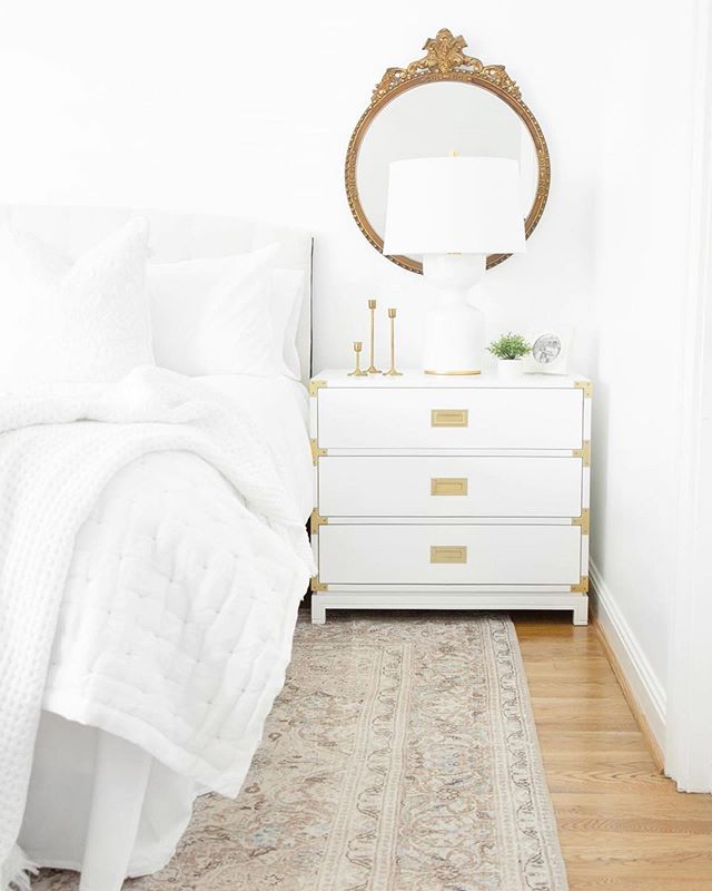 """We can't get over this amazing bedroom makeover that @samcramdesign did for her Mom 😍 The perfect balance of modern and traditional, the space includes a pair of our Small Carlyle Campaign Dressers used as nightstands. """"They are stunning!"""" Sam says of the dressers, """"I love the brass hardware and sleek white material. And they provide great additional storage for my mom!"""" Head over to Sam's blog to read the full post and view more photos of the project."""