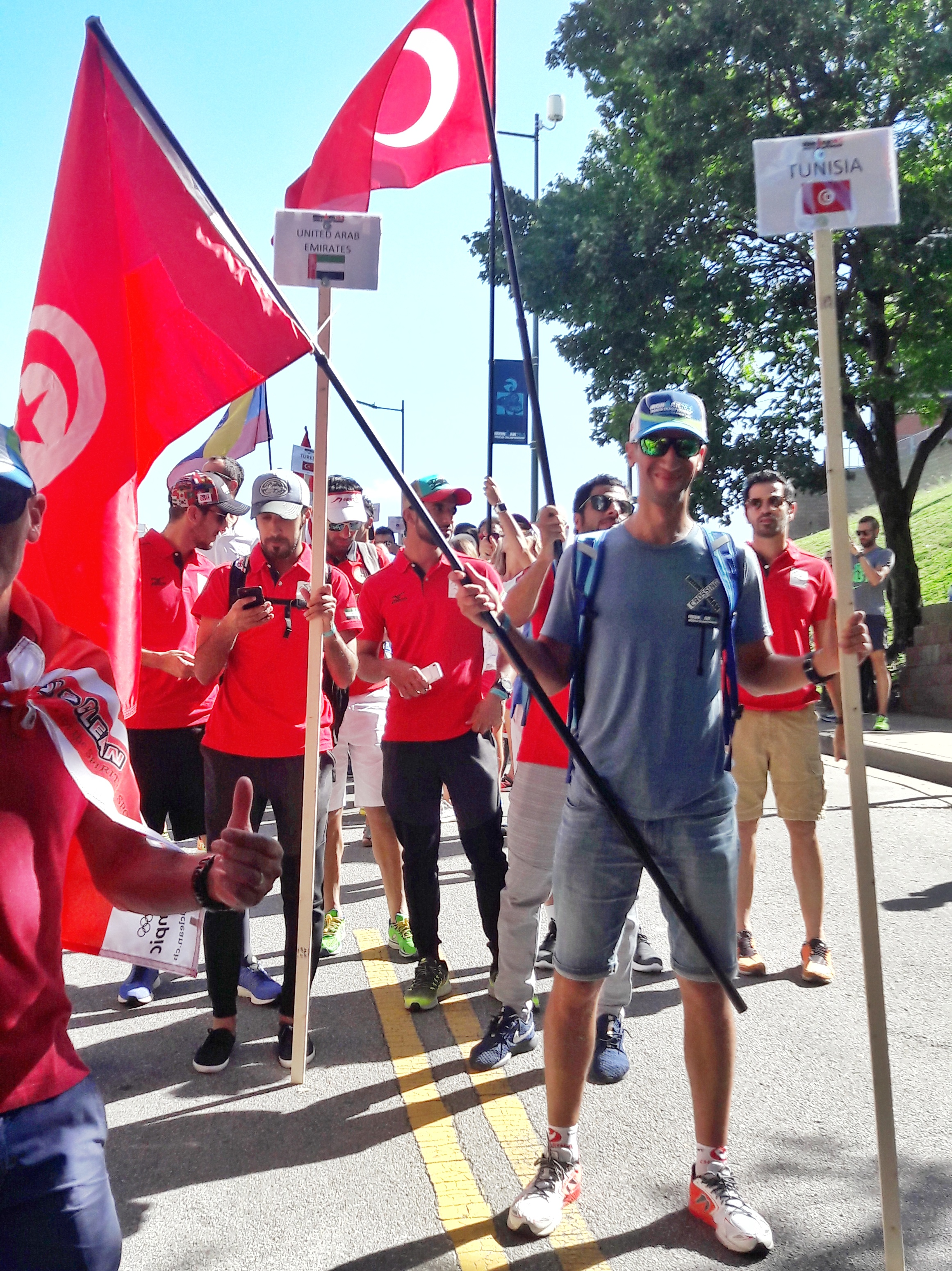 Proudly holding the Tunisian flag at the parade of nations.