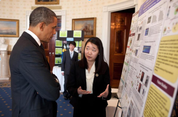 President Barack Obama listens to Angela Zhang as she shares her research on nanotechnology at the White House Science Fair, held on Feb. 7, 2012.   PHOTO BY PETE SOUZA/COURTESY OF ANGELA ZHANG