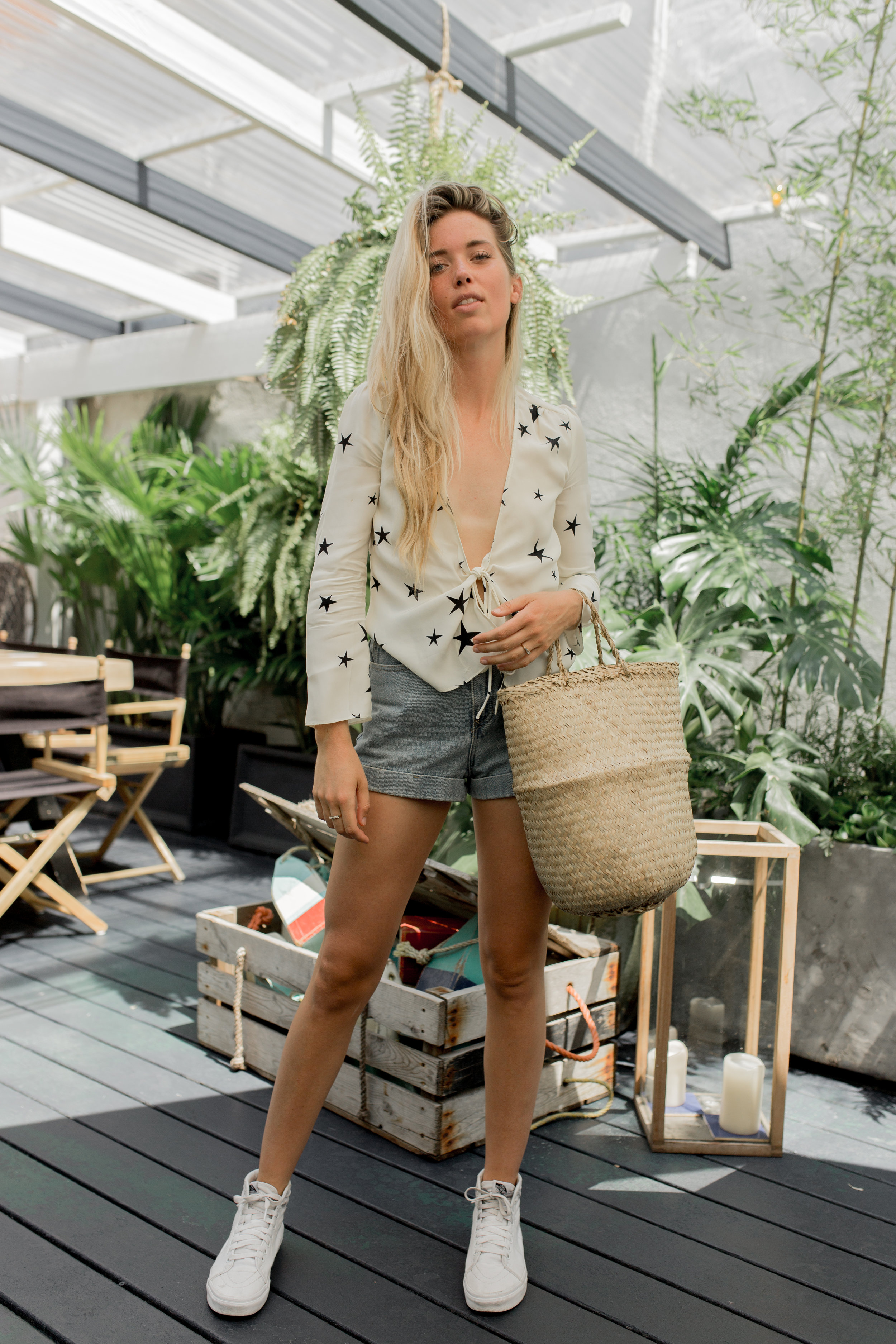 "Denvre is wearing: Réalisation Par's  ""The Bianca - Cream Superstar""  top, vintage-style denim shorts by  American Apparel  & basket bag by  Reformation  (Shoes: model's own)."