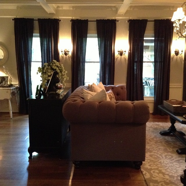 When we bought this custom made Chesterfield sofa, it completely changed our family room! From there, everything took on a life of its own! {Of course then we needed new chairs, a rug, curtains and a whole new paint color..} but you know how that happens, right?!?
